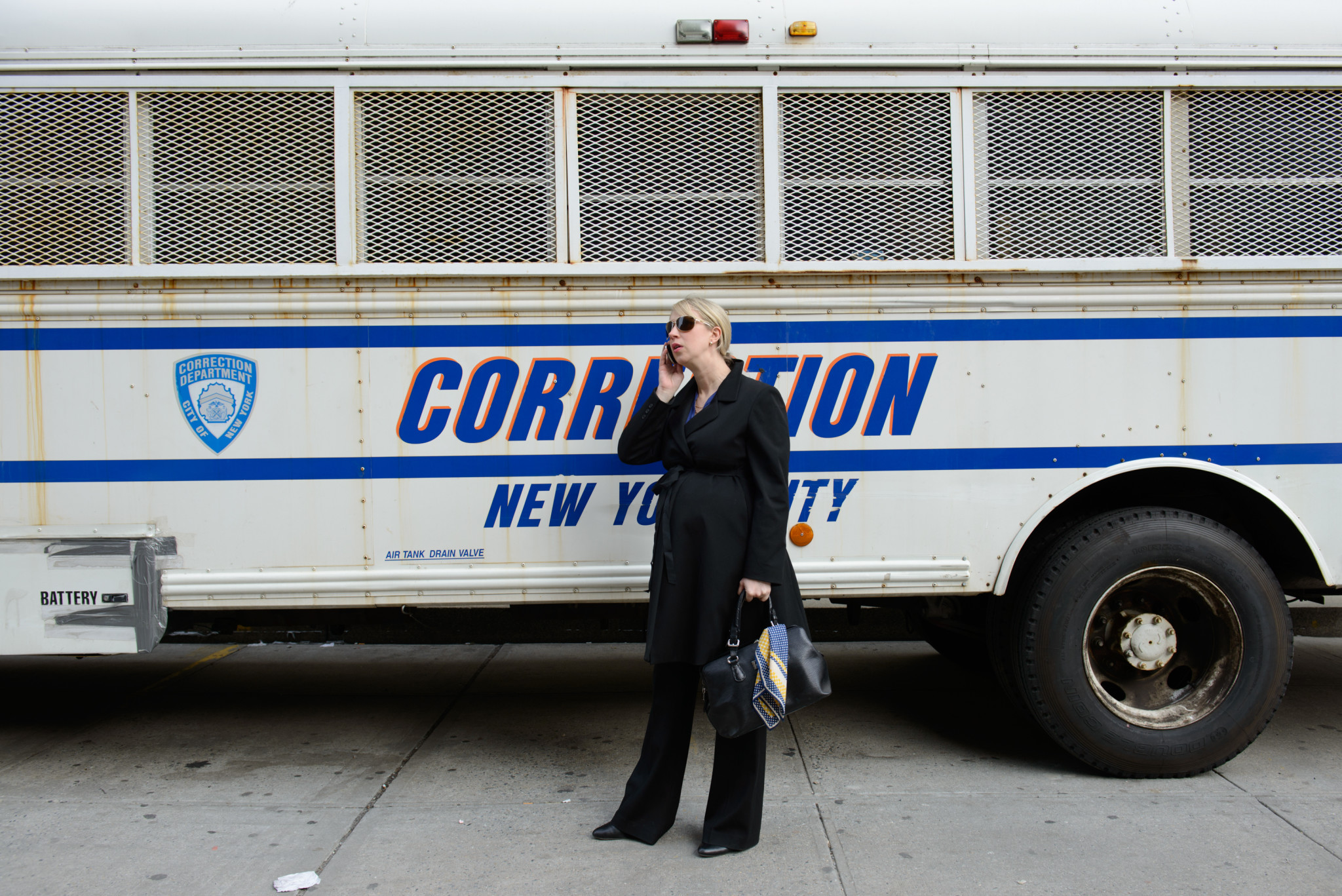 Assistant District Attorney Lucy Lang takes a call outside of her office.