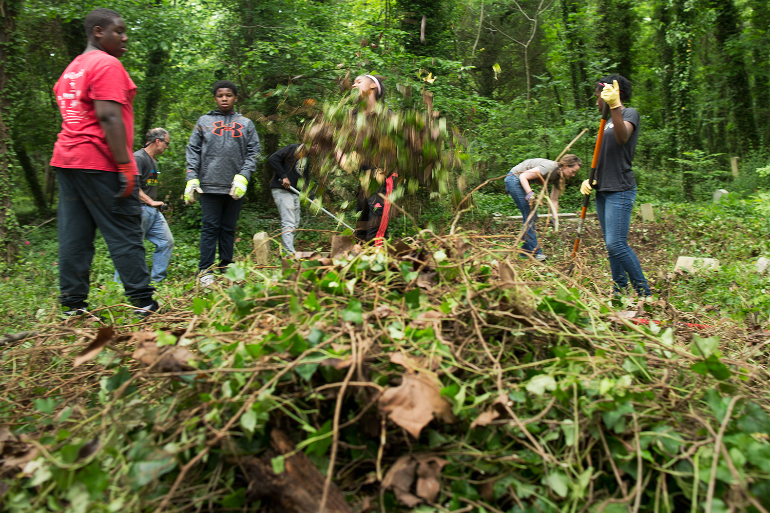 Students from Richmond's Anna Julia Cooper Episcopal School help clear a section of the East End Cemetery.