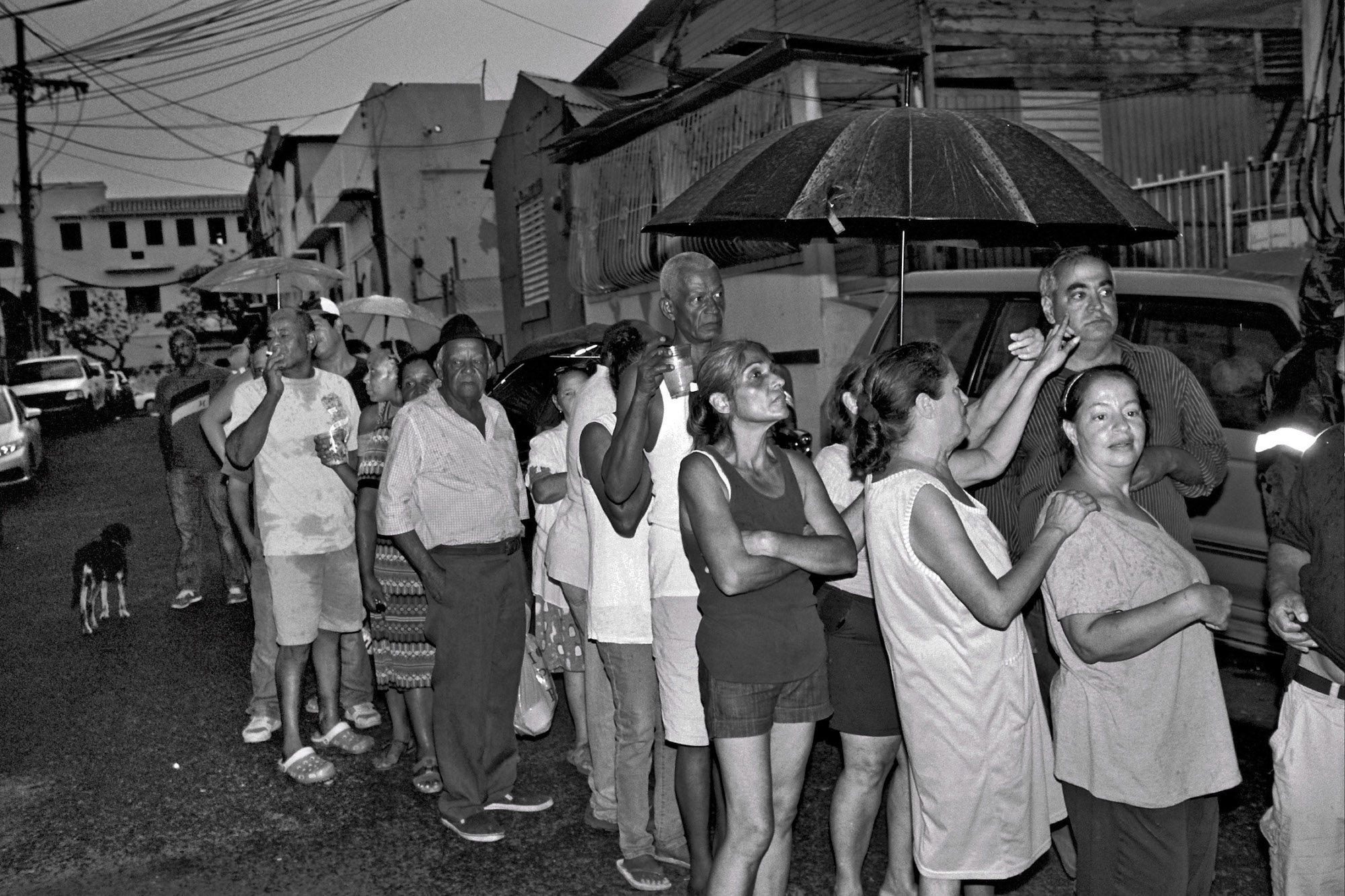People lined up for hours one night in the rain to get food and water in Santurce, San Juan, P.R.