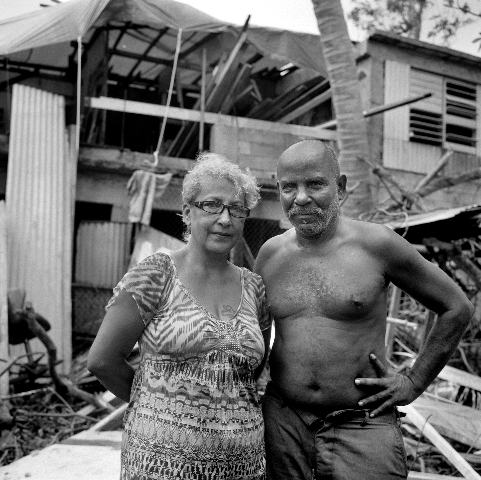 Ilda Sanchez 56, with her husband Alberto Luquis, 62. During the hurricane they found a dead six-foot long alligator in their backyard. The house was also under water up to his chest.