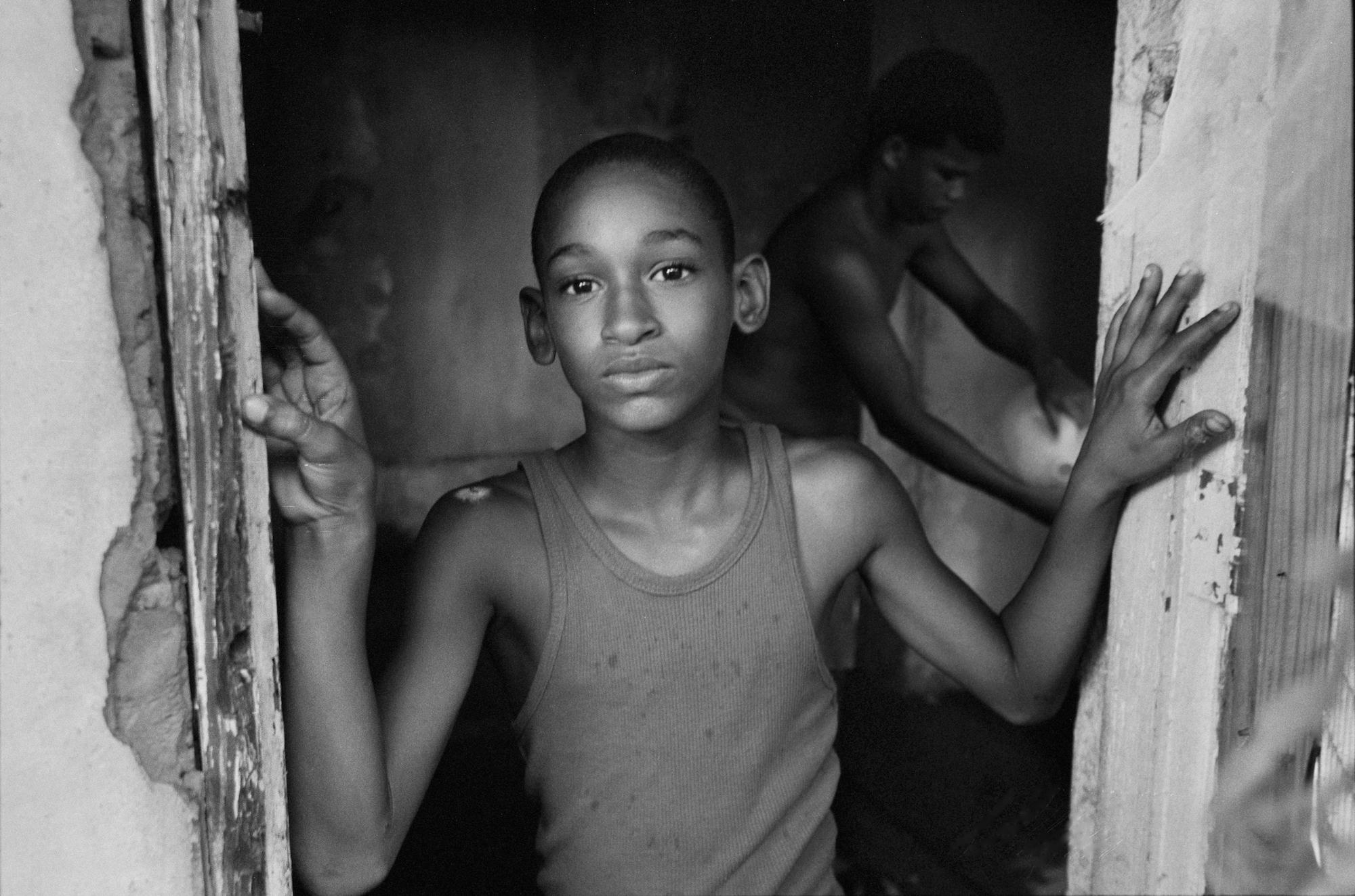A boy playing in an abandoned house in Caño Martín Peña