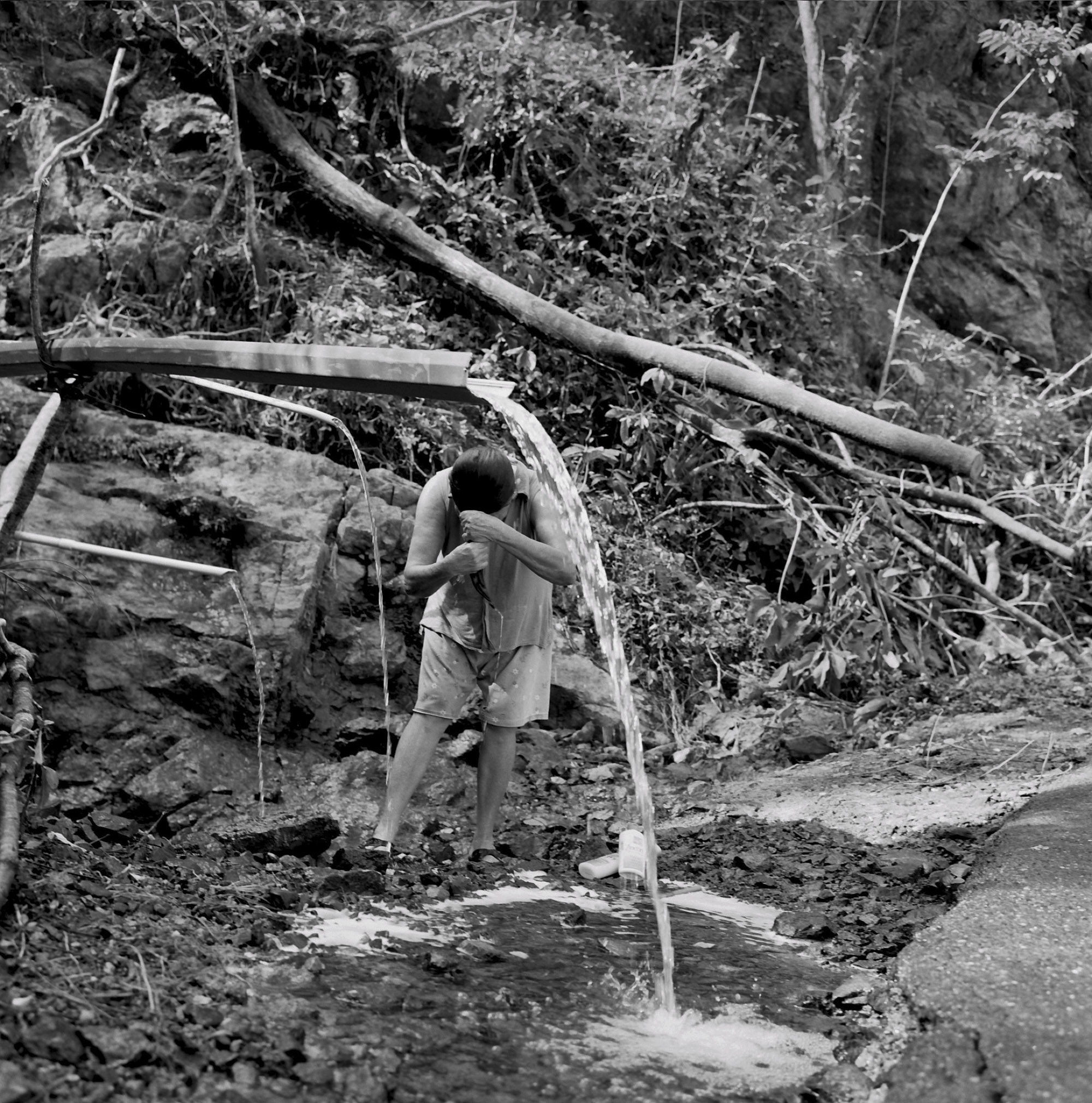 Residents of Utuado must collect water from the mountain stream to wash themselves and their clothes, and to cook.