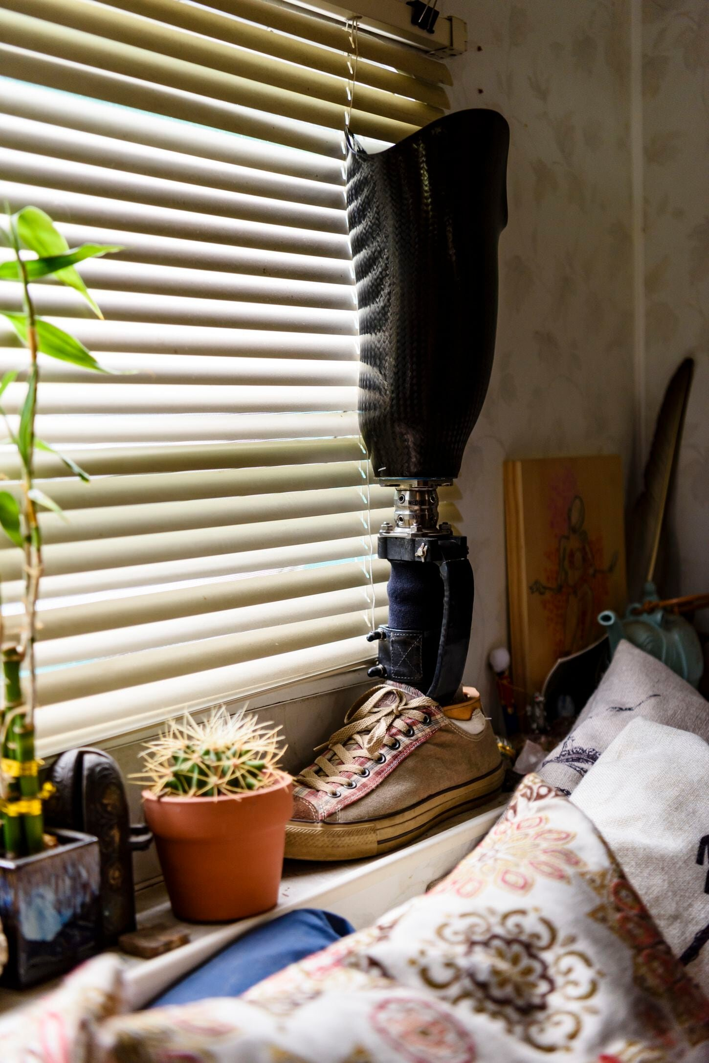 At her home in Drain, Ore., Karie Fugett displays the prosthetic leg that belonged to her husband, Cpl. Jimmy Cleveland Kinsey II, who was wounded in Iraq in 2006. (Photos by Leah Nash)