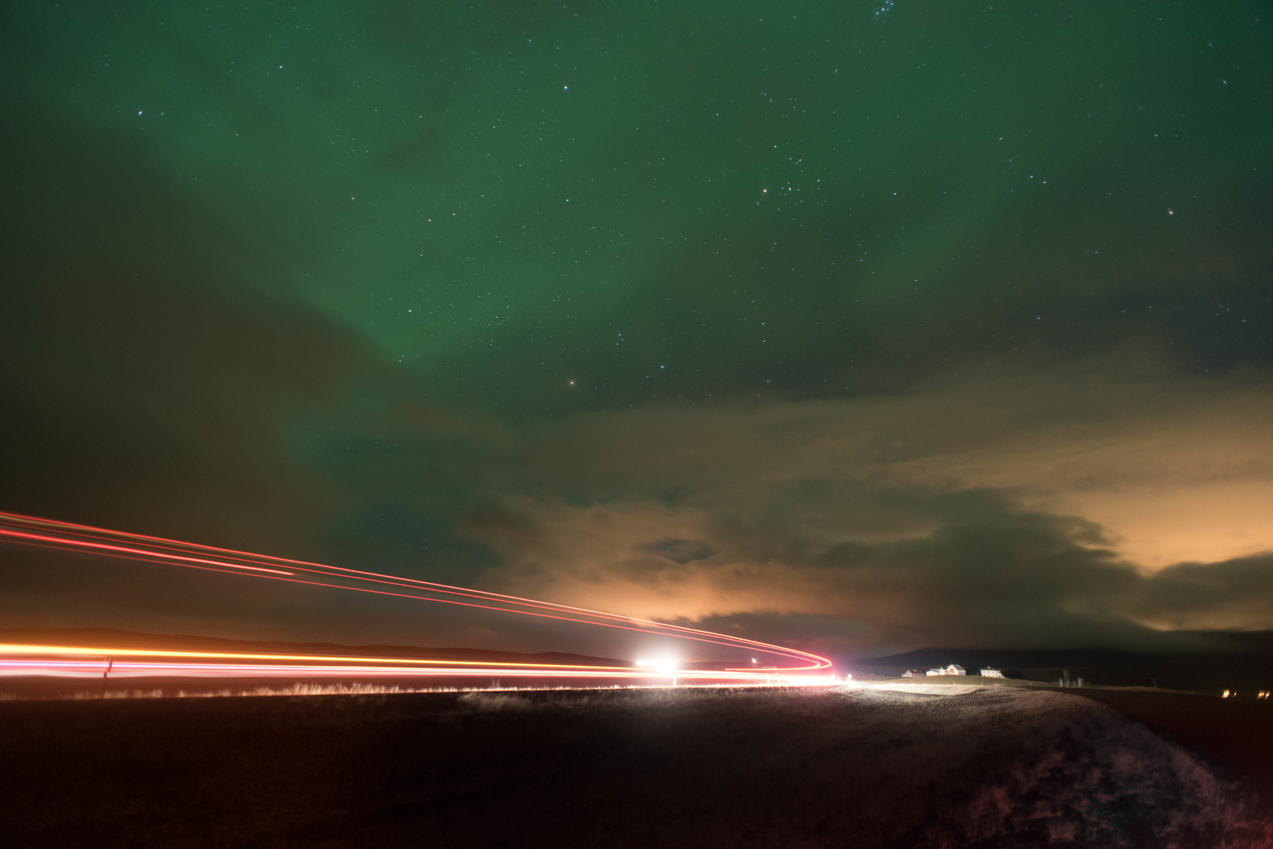 Aurora under light trails