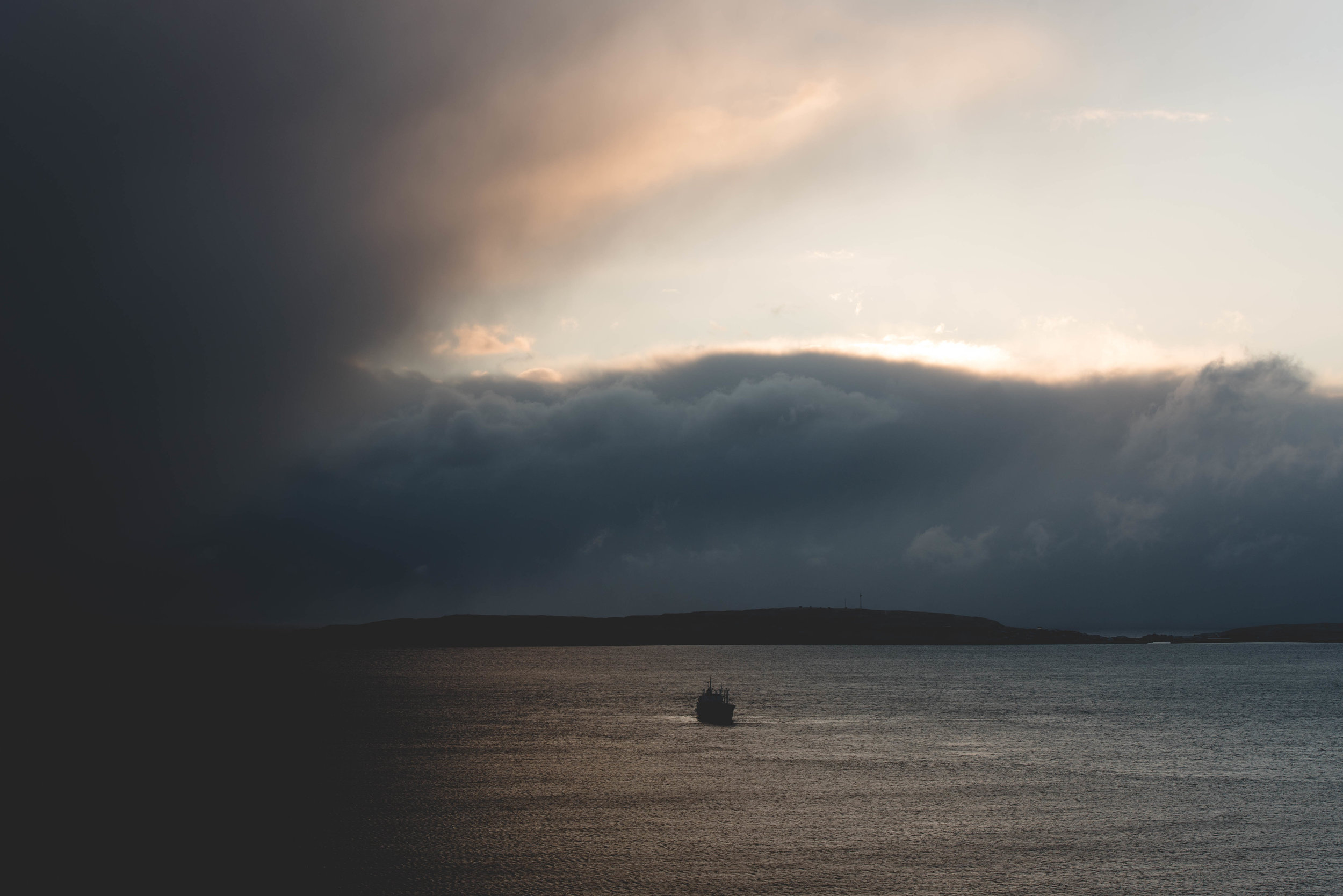 Sunrise over Nolsoy, storm clouds dissipating
