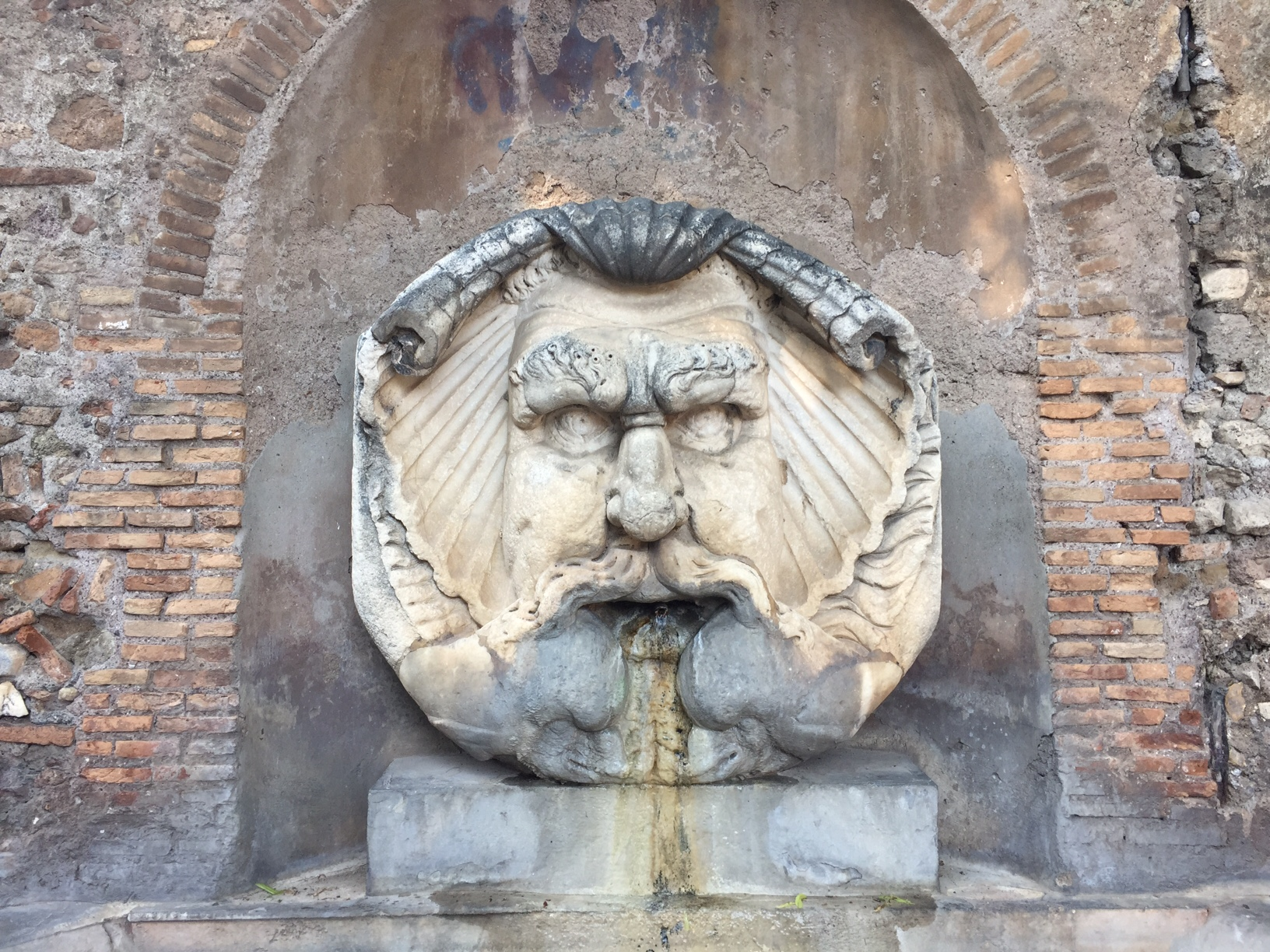 Drinking fountain outside the Basilica of Santa Sabina on the Aventine Hill in Rome.