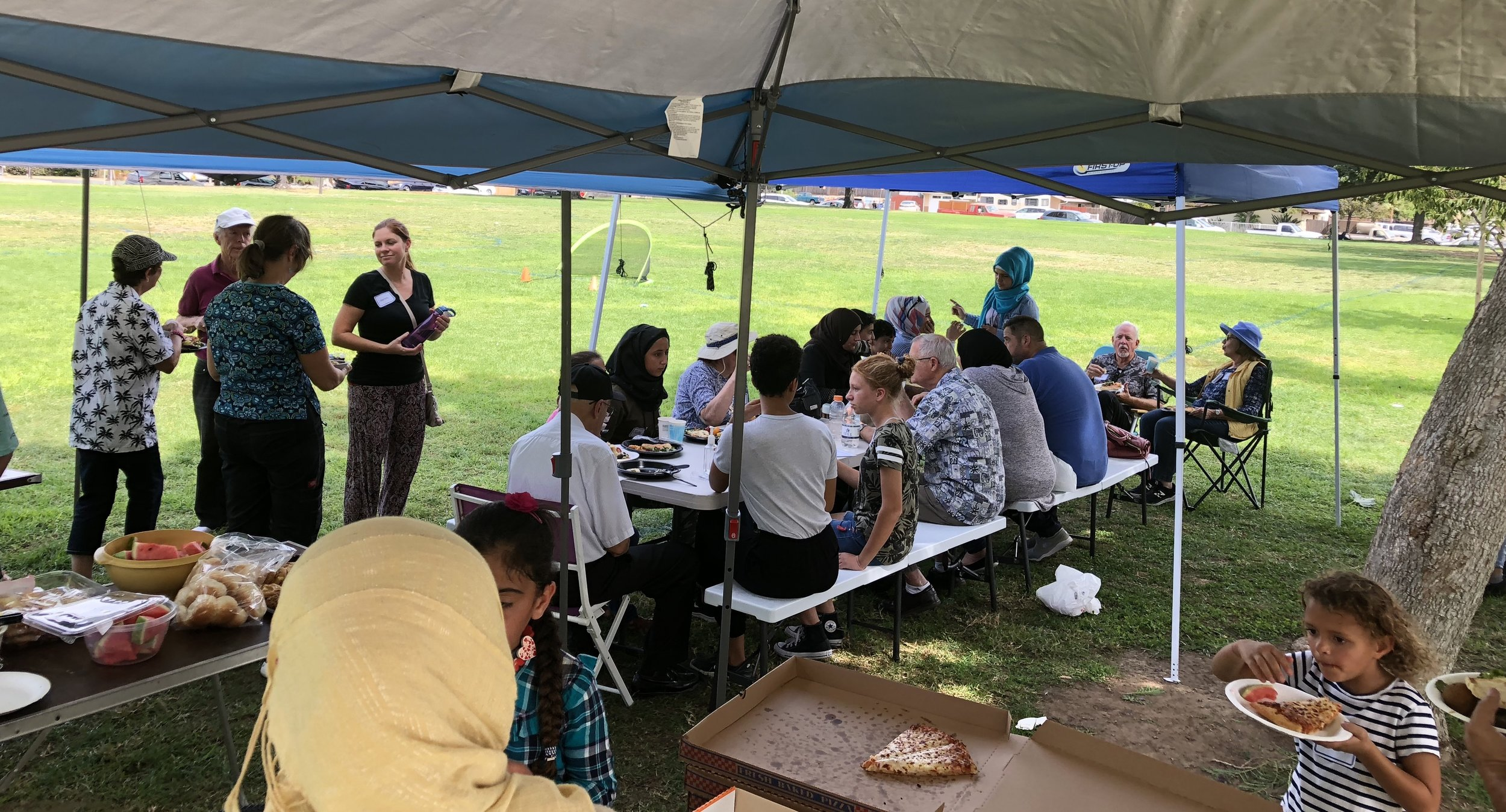 The group met with Syrian refugee families for a picnic at a local park.