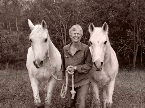 Woman with 2 horses.jpg
