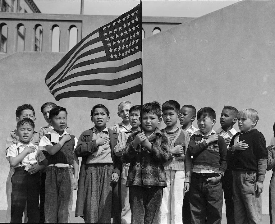 """""""Children pledging allegiance to the American flag at San Francisco's Raphael Weill Elementary School in 1942. Those whose families were of Japanese ancestry were sent to internment camps.""""  Dorothea Lange captured a set of """"rarely seen photos"""" on the subject of Japanese internment throughout the 1940s. Text from  The New York Times"""