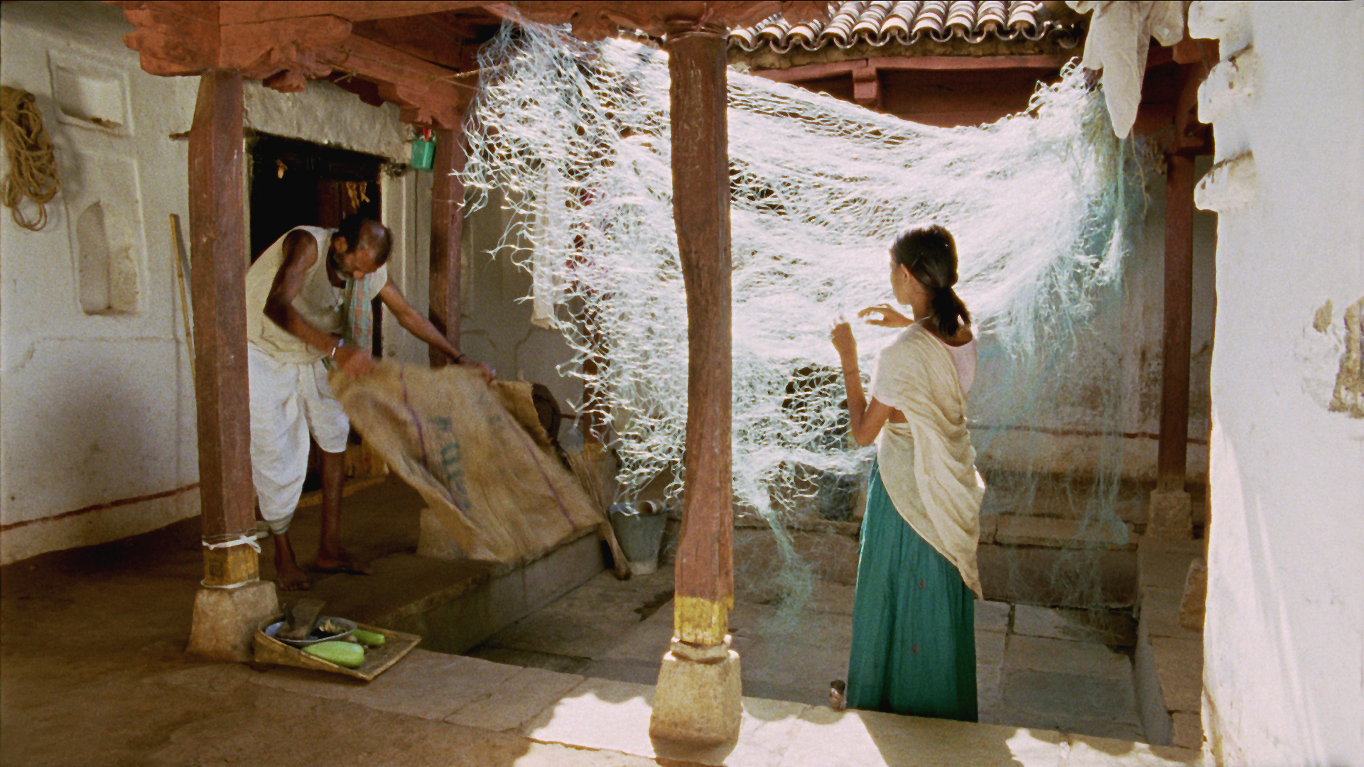 Vanaja and Somayya mending Net.jpg
