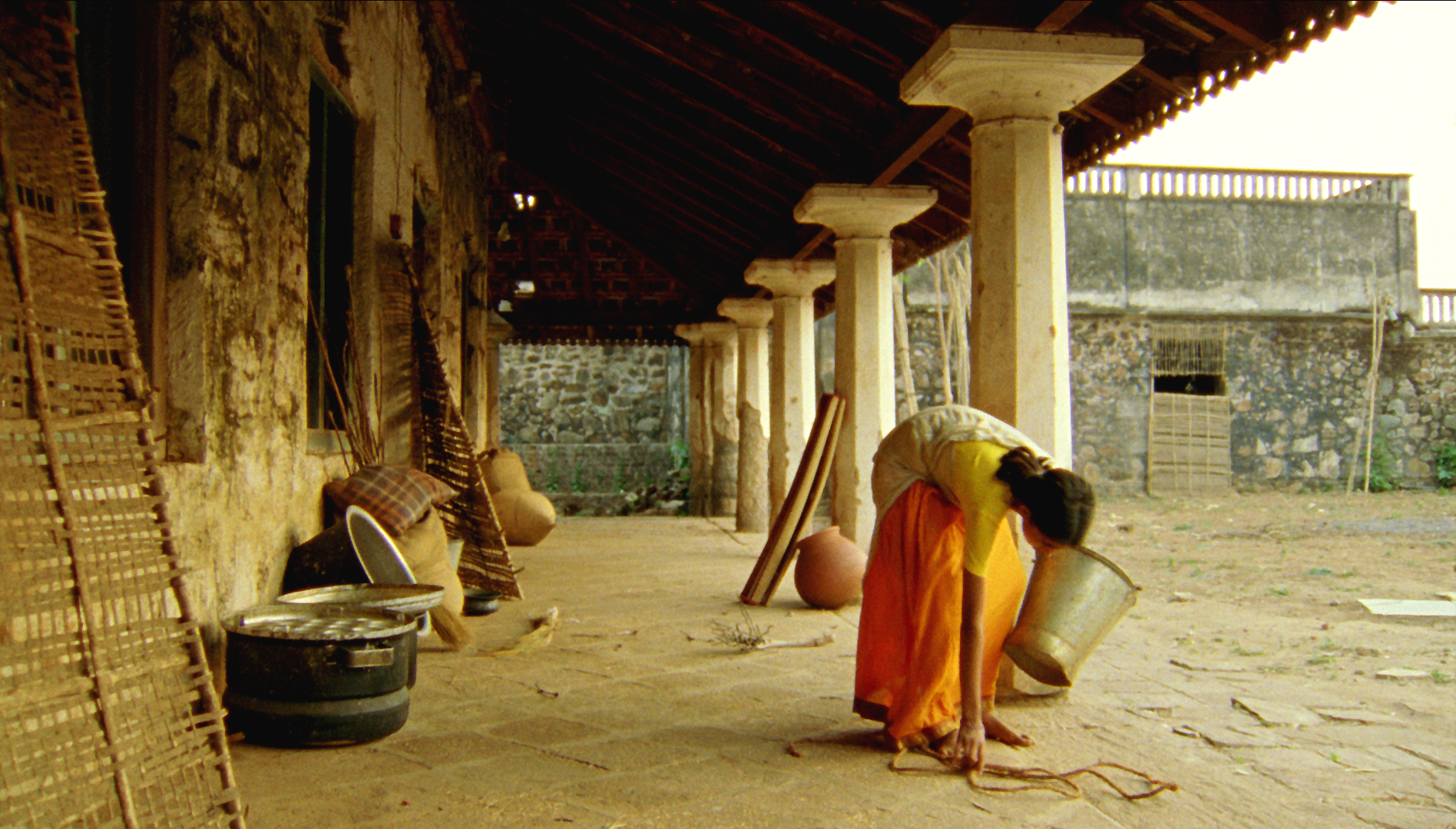 Vanaja singing and Cleaning yard.jpg
