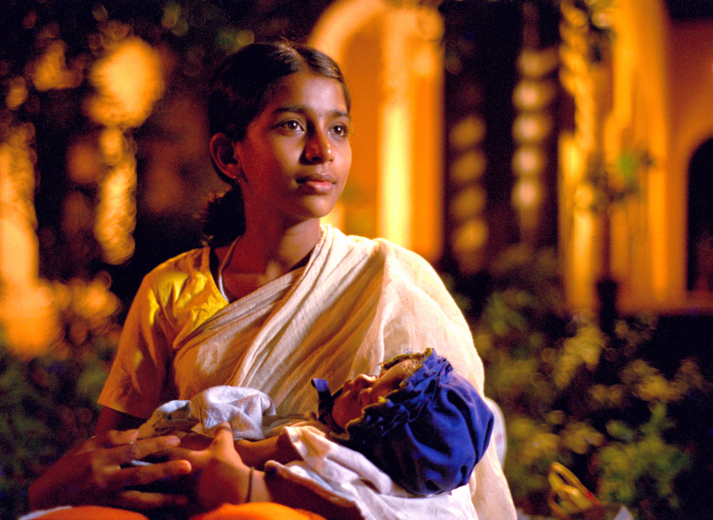 Vanaja feeding her infant.jpg