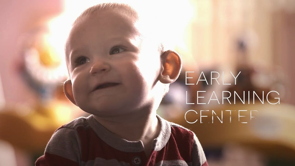 Adorable screenshot of a baby boy in the Excel Video.