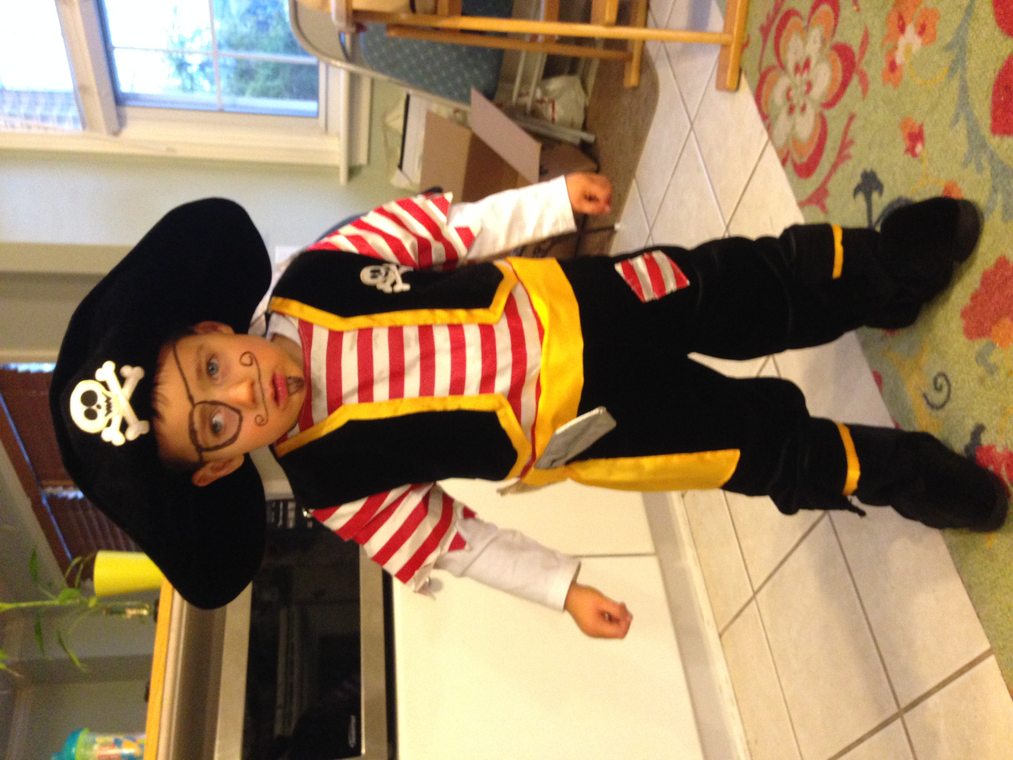 He was able to stand and take a couple steps without assistance by Halloween 2013. My little pirate!