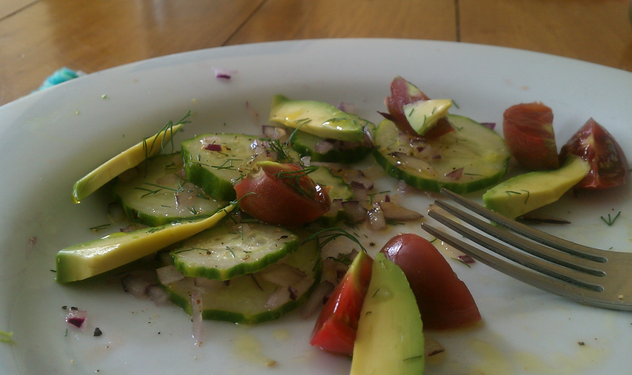 avocado, cucumbers, and black prince tomatoes in vinaigrette