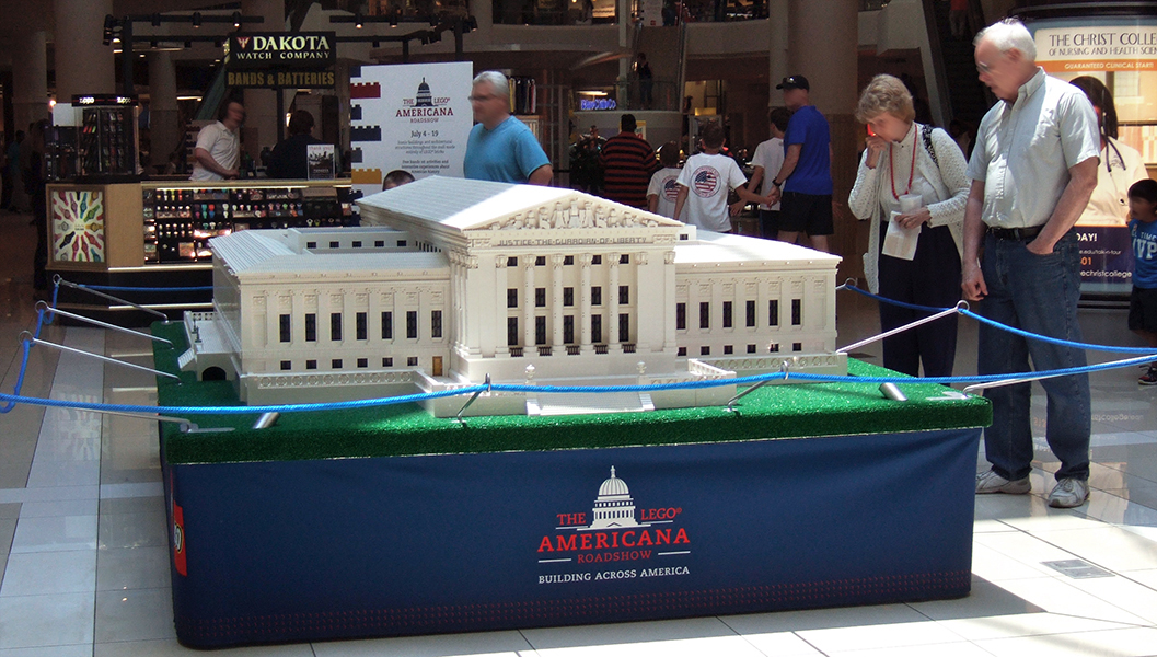 """The U.S. Supreme Court Building, 450 hours to assemble at 1:54 scale. I like this photo from the back, because of the people looking on, but the """"front entrance"""" is on the other side, with two LEGO statues and a noticeable yellow/gold door."""