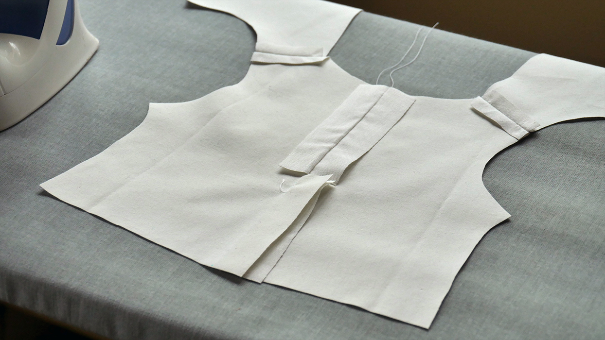 """Open your back seam and press it flat. This is what your jacket should look like from the """"wrong"""" side. Notice that I did not open the back vent! Press it over to one side or the other, so that one edge is folded under the overlapping edge."""
