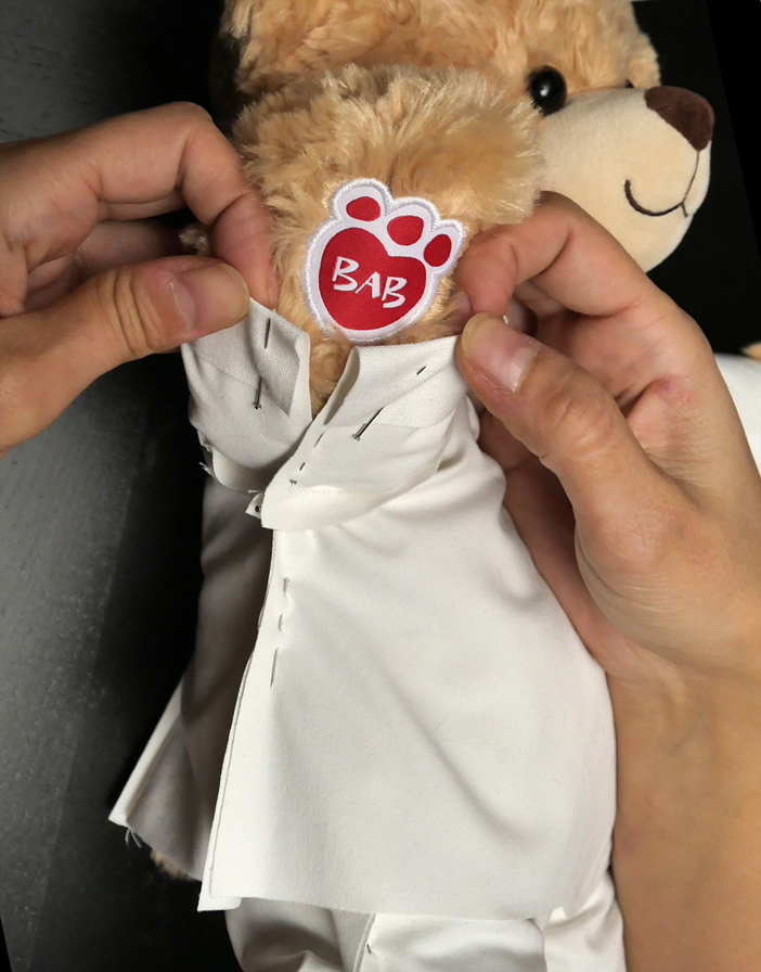Adjusting the length of your sleeves is as easy as folding and pinning. I recommend making them short enough to show off your BAB logo!