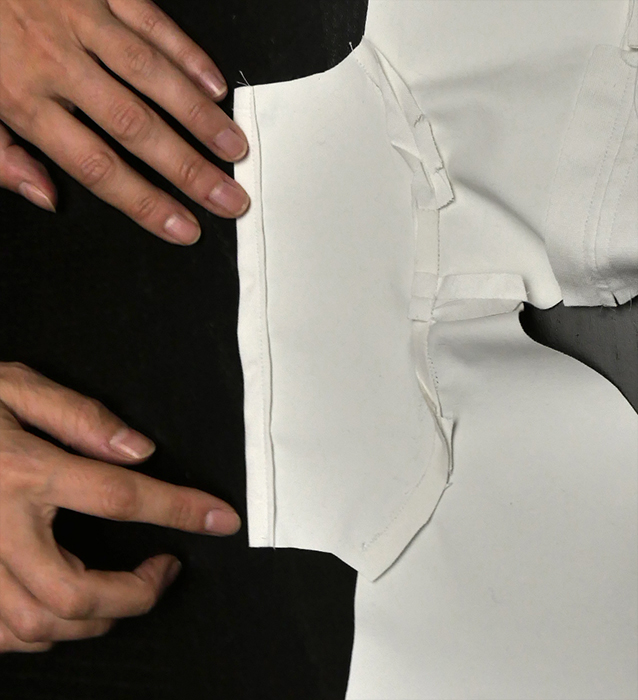 """Run a seam at each cuff while the jacket is lying """"flat"""" or open. It's much easier to do this  before  you sew each of the side seams. if it's already too late, consider sewing the cuffs by hand."""