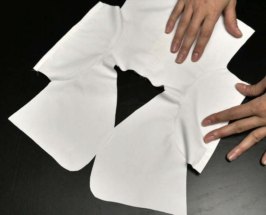 Now use the edge of each cuff to guide you in preparing the side seams.