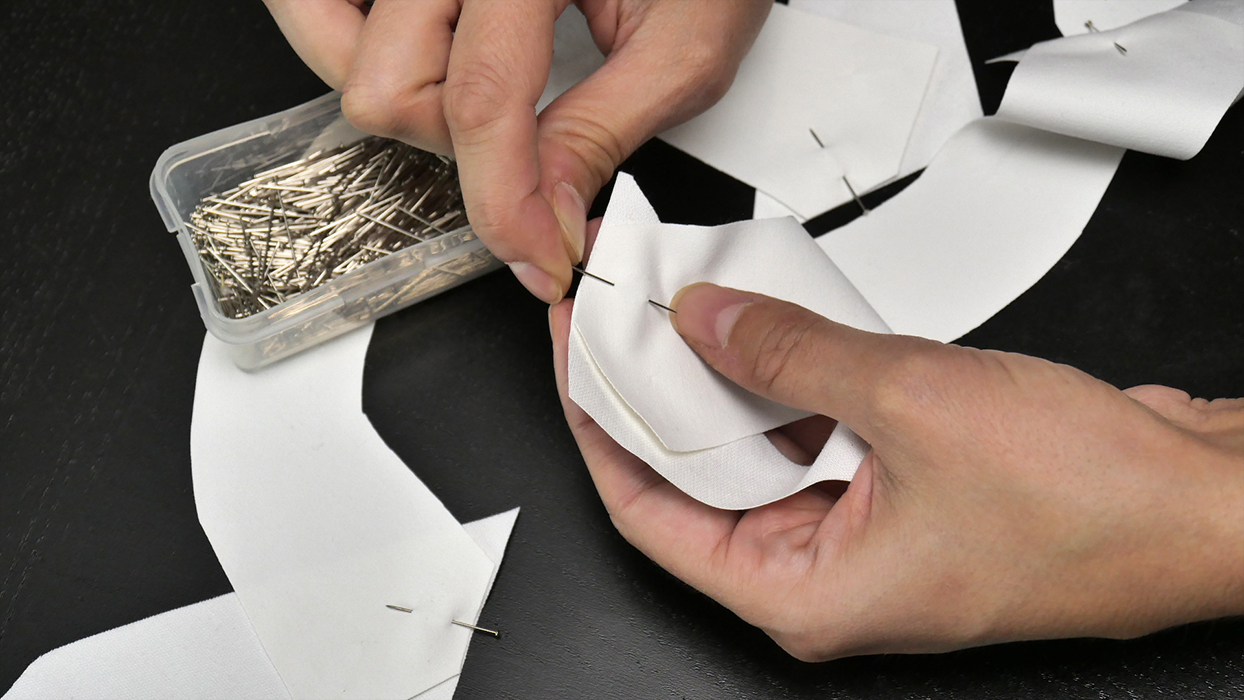 Align pieces of your lapel and pin to secure. For best results, use the marks on your paper pattern to help you determine how and where these pieces match up.