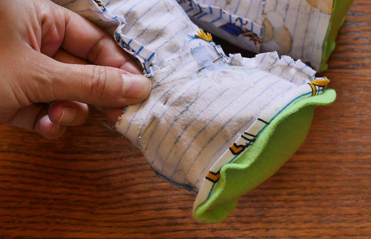 Pin or mark where each pant leg meets each footie.