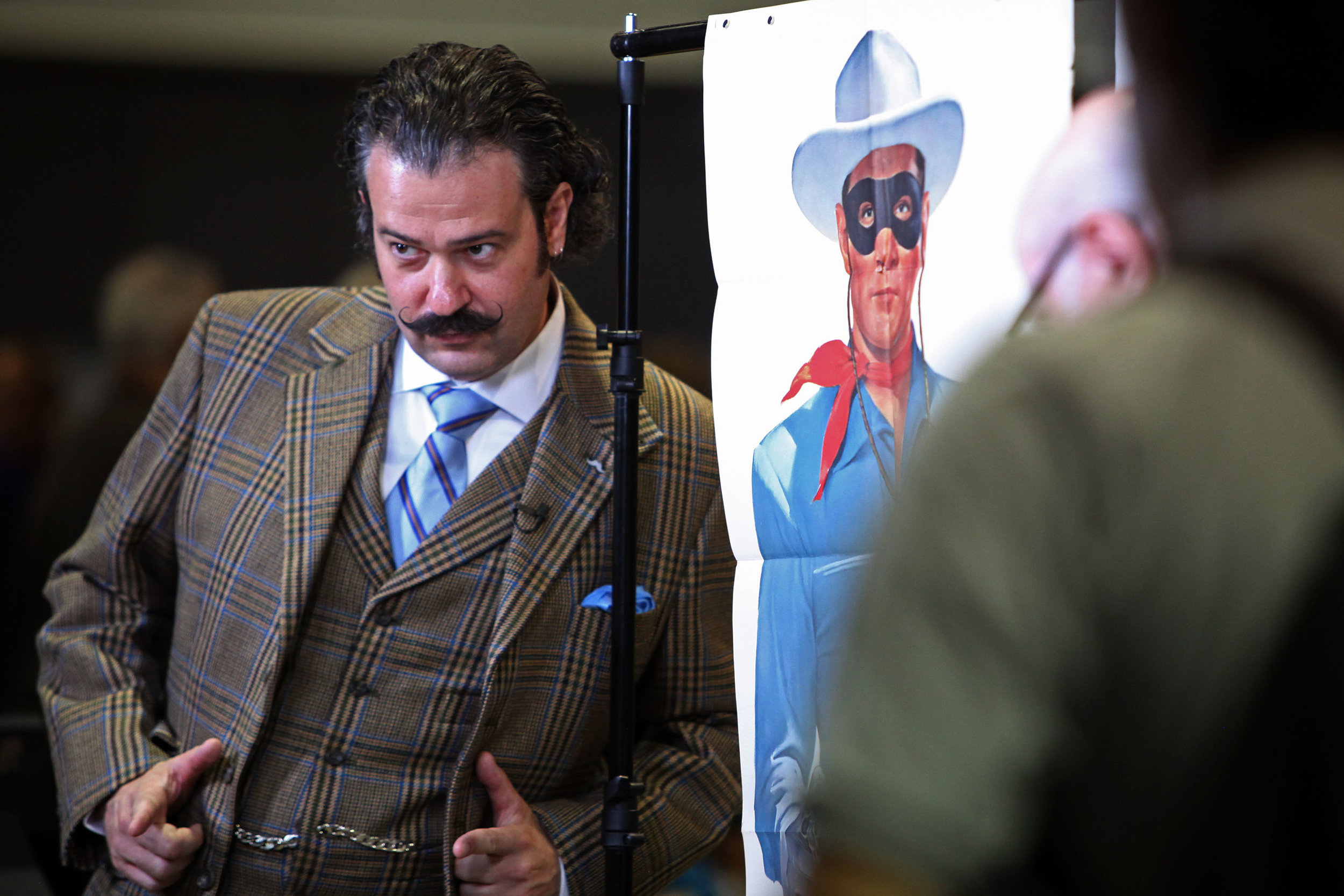 Nicholas Lowry, at left, a vintage poster specialist and appraiser from New York City, poses with a life-sized poster of the Lone Ranger that Tom, of Albuquerque, brought in to be appraised along with a matching poster of Tonto to the Antiques Roadshow at the Albuquerque Convention Center, July 19, 2014, in Albuquerque NM. After the appraisal, Lowry had an impromptu photo session of himself with the posters, including a few selfies. (Morgan Petroski/Journal)
