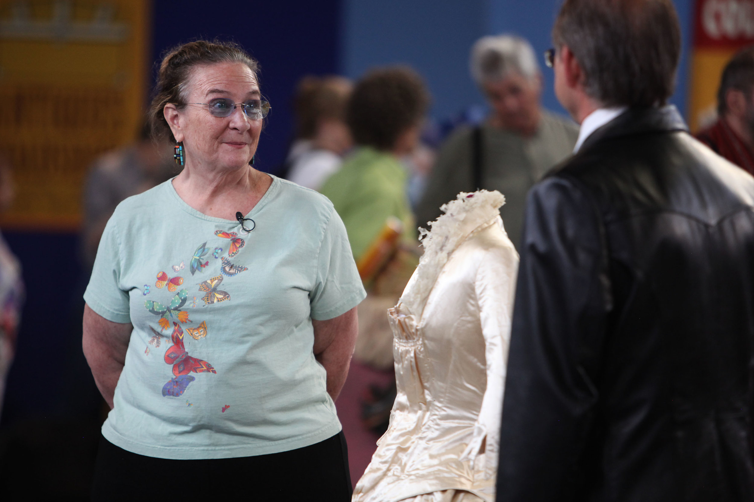 Alana, of Corrales and Santa Fe, reacts as Steven Porterfield, of Midland, TX, appraises her 1870s satin wedding dress at the Antiques Roadshow at the Albuquerque Convention Center, July 19, 2014, in Albuquerque NM. Alana's mother bought an antique trunk in 1956 for Alana to play dress up with the clothing inside and the wedding dress was at the bottom of the trunk.(Morgan Petroski/Journal)