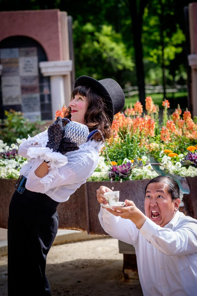 man catches tea from mad hatter