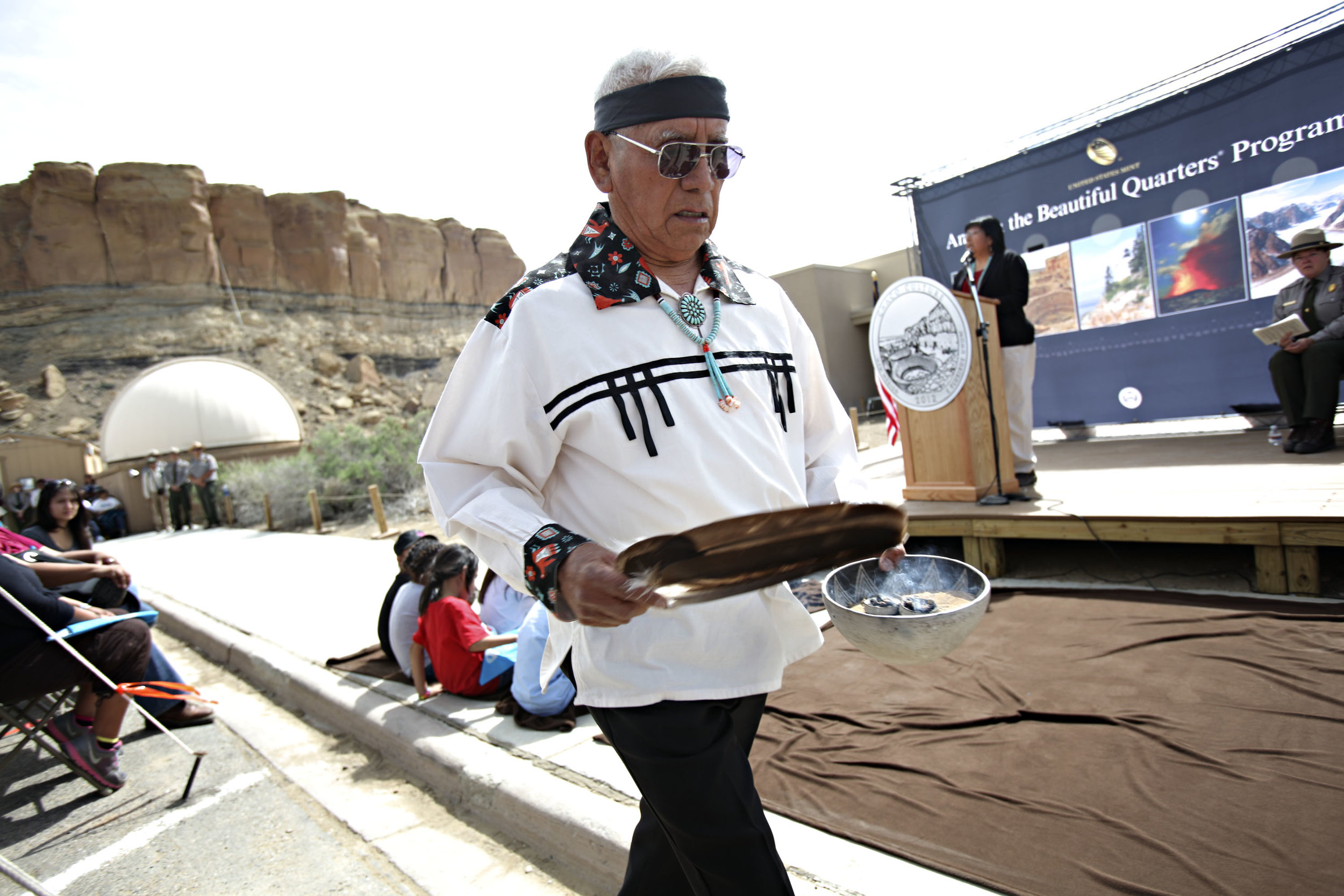 Councilman Ernest M. Vallo Sr., of Acoma Pueblo blesses the new Chaco Canyon visitor center during the quarter launch at Chaco Canyon, Thursday, April 26, 2012. (Morgan Petroski/Albuquerque Journal)