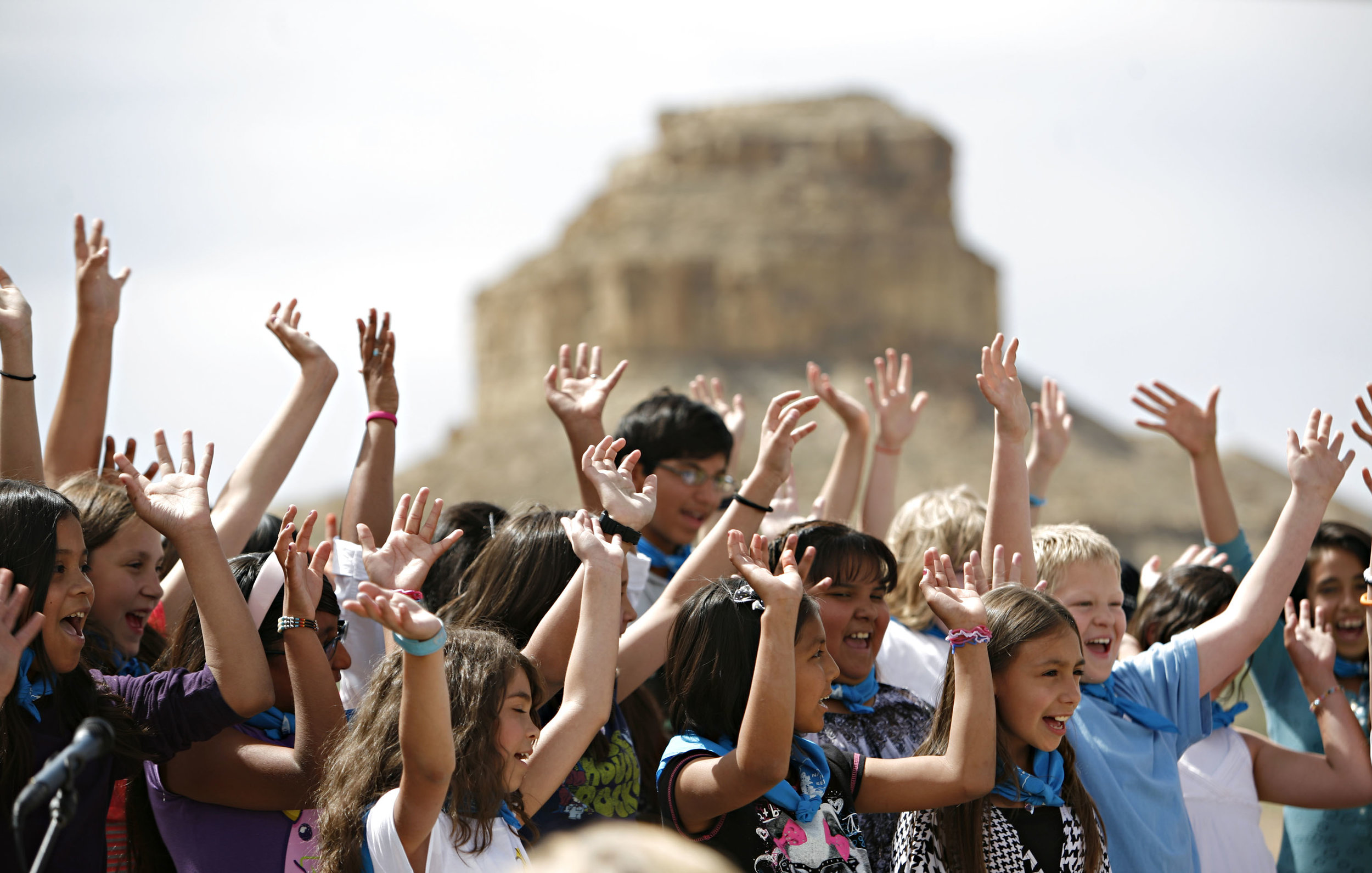 The Apache Elementary Honor Choir performs in front of Fajada Butte during the Quarter launch at Chaco Canyon, Thursday, April 26, 2012. (Morgan Petroski/Albuquerque Journal)