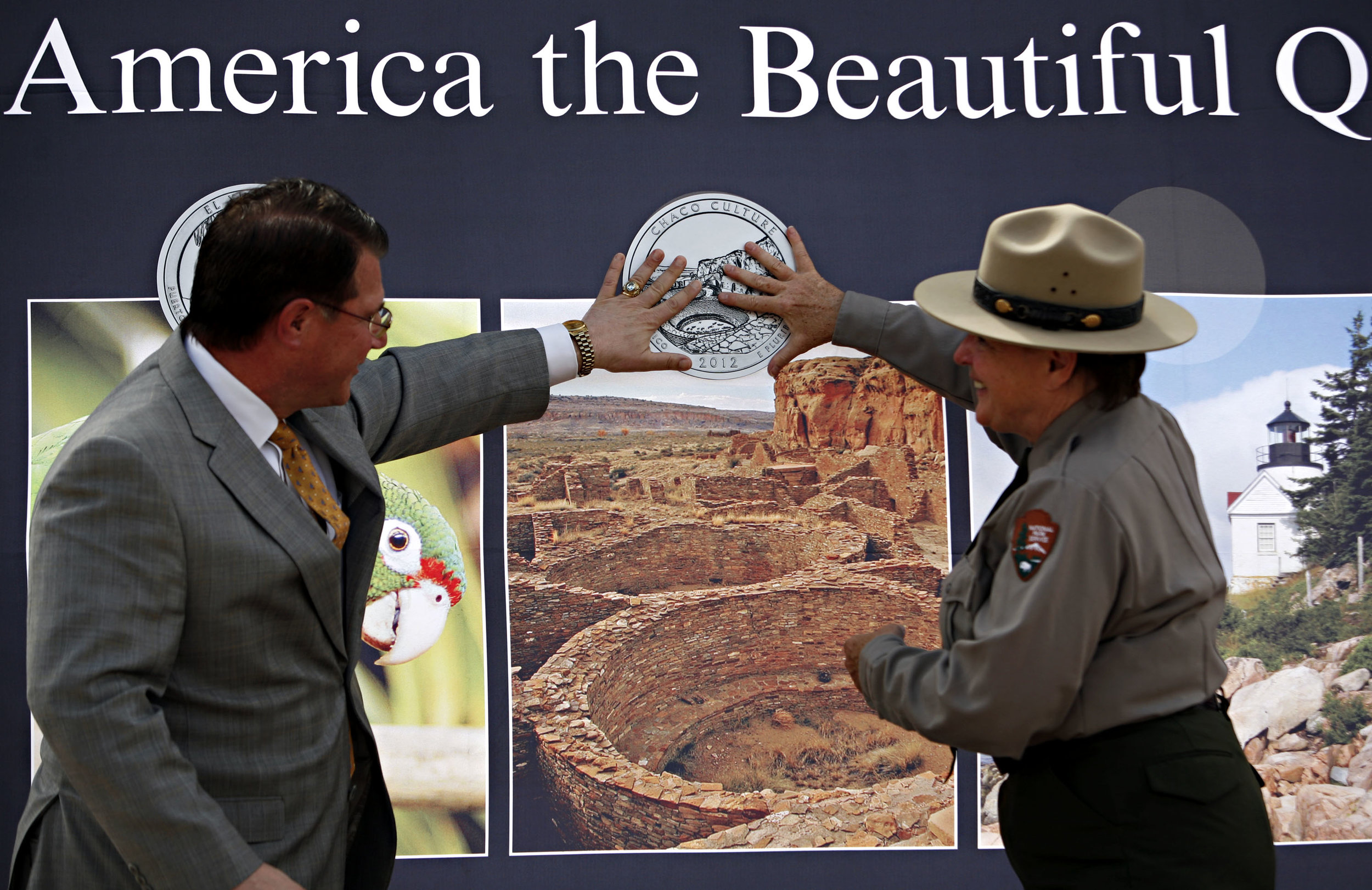 At left, Deputy Director of the United State Mint Richard Peterson and Superintendent of Chaco Culture NHP Barbara West officially launch the Chaco Canyon quarter, Thursday, April 26, 2012. (Morgan Petroski/Albuquerque Journal)