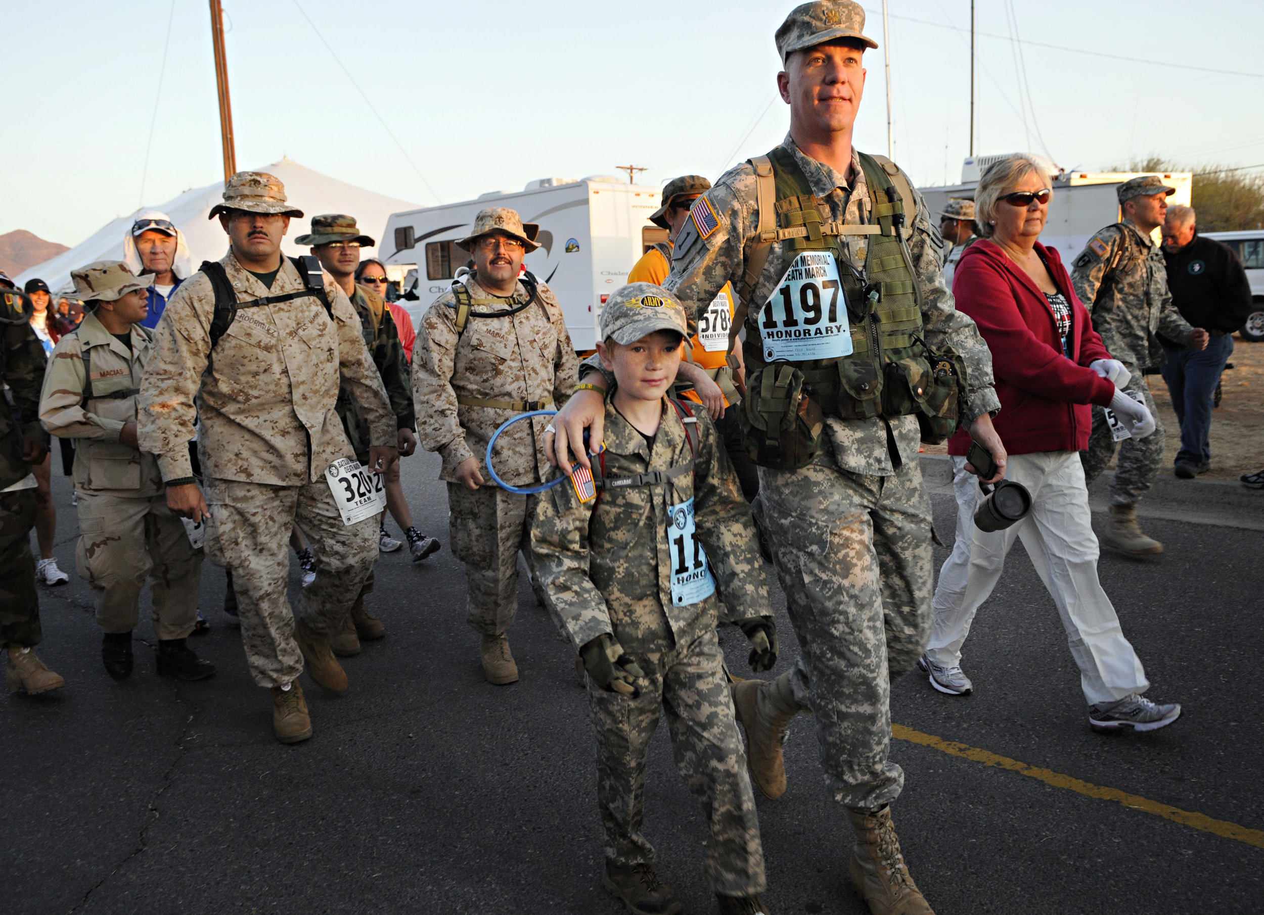 Kein Bolke and his son, Max Bolke, 9, of White Sands, begin their 15.2-mile walk during the 22nd Annual Bataan Memorial Death March at White Sands Missile Range, Sunday, March 27, 2011. This was Max's first Bataan walk and he later said it was good and that he would do it again next year. (Morgan Petroski/Albuquerque Journal)