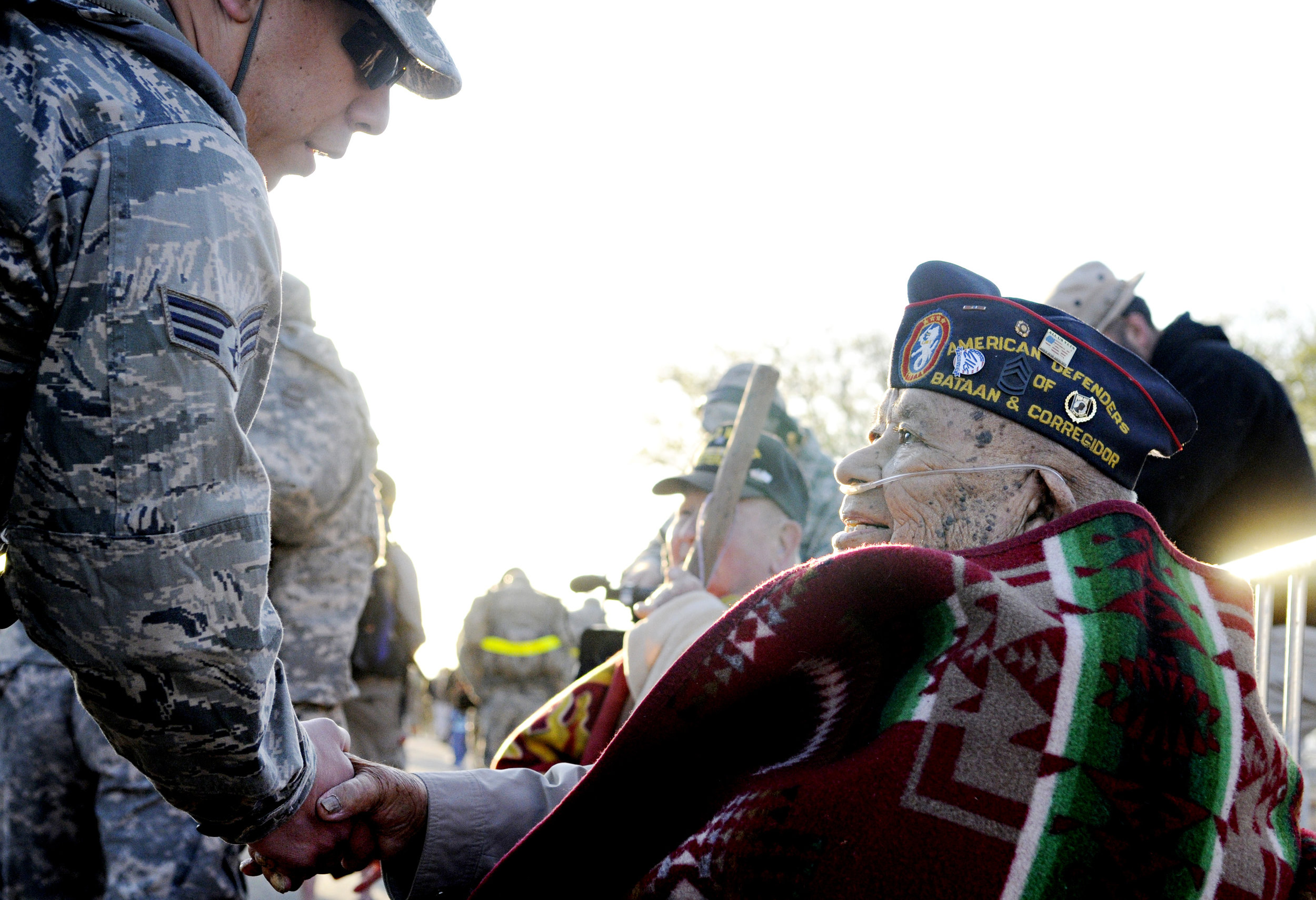 """Bataan survivor Sam Juan Antonio, sends off the walkers with the phrase """"No Blisters"""" during the 22nd Annual Bataan Memorial Death March at White Sands Missile Range, Sunday, March 27, 2011. (Morgan Petroski/Albuquerque Journal)"""