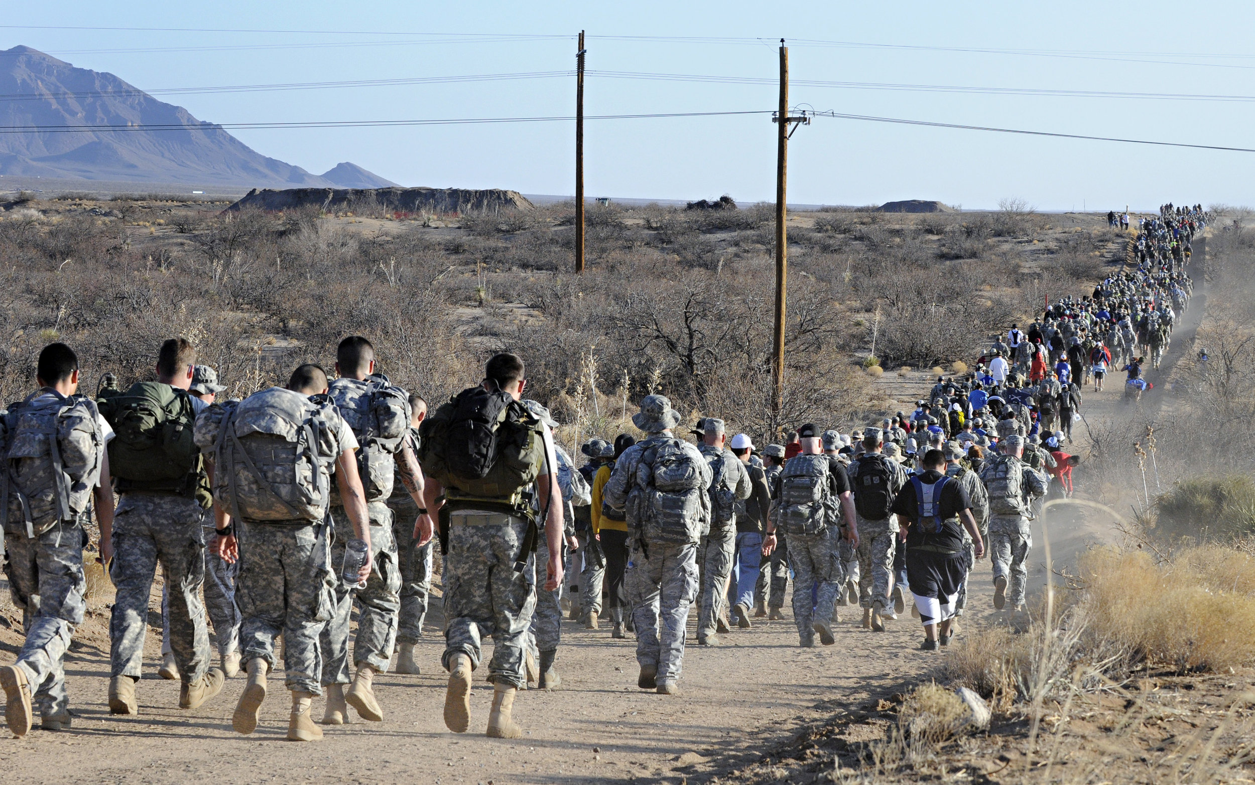 Walkers hike through the White Sands Missile Range during the 22nd Annual Bataan Memorial Death March, Sunday, March 27, 2011. (Morgan Petroski/Albuquerque Journal)