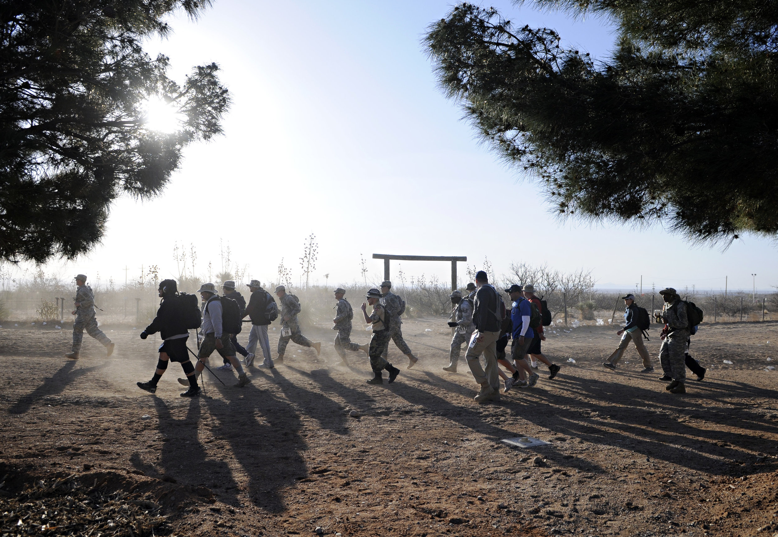 Walkers and runners kick up some dust along with the strong winds that seemed to last all day during the 22nd Annual Bataan Memorial Death March at White Sands Missile Range, Sunday, March 27, 2011. (Morgan Petroski/Albuquerque Journal)