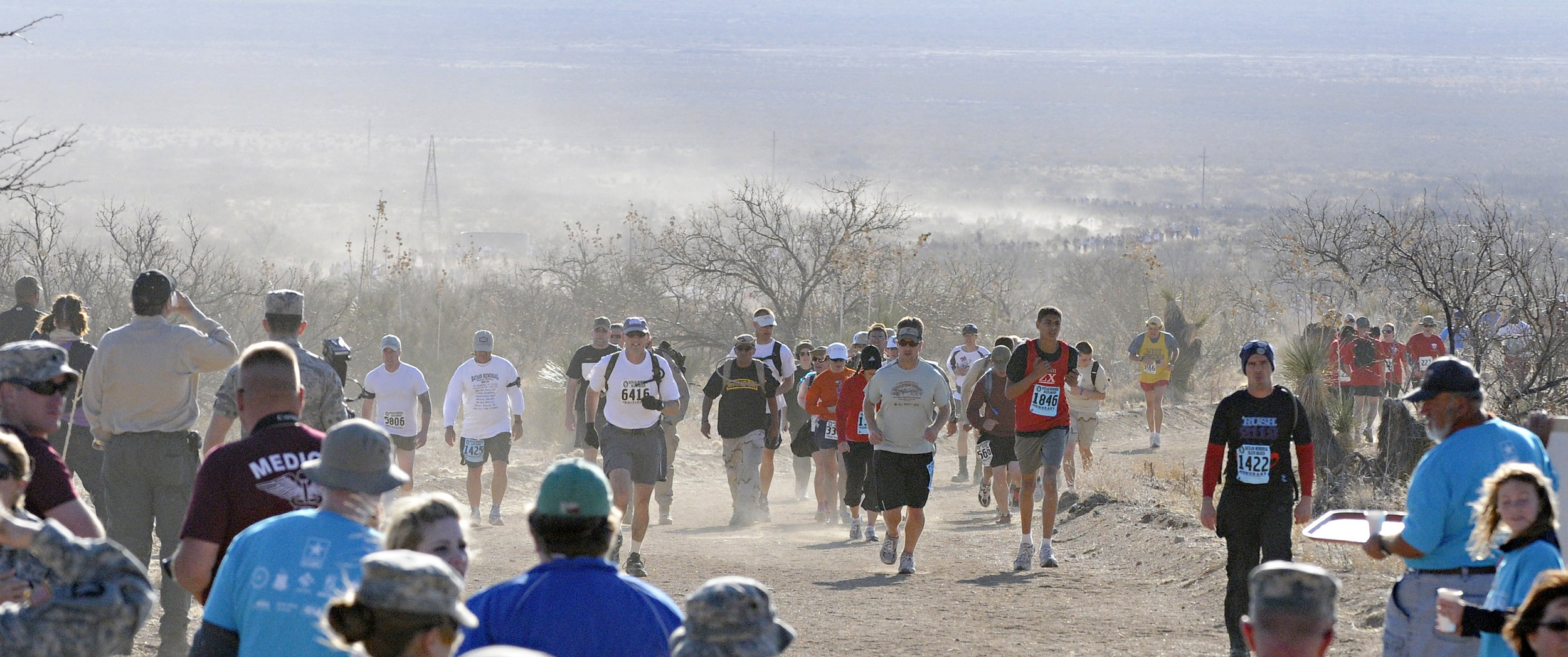 Walkers and runner emerge from the dusty desert of White Sands Missile Range during the 22nd Annual Bataan Memorial Death March, Sunday, March 27, 2011. (Morgan Petroski/Albuquerque Journal)