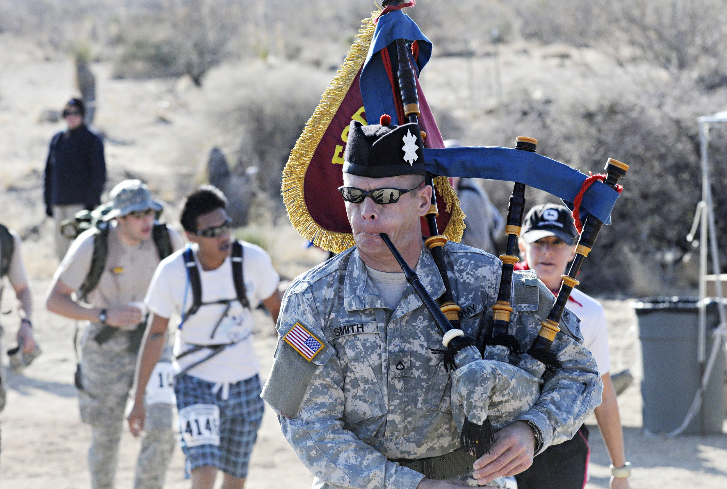 Angus Smith plays the bagpipes while marching in the 22nd Annual Bataan Memorial Death March at White Sands Missile Range, Sunday, March 27, 2011. (Morgan Petroski/Albuquerque Journal)
