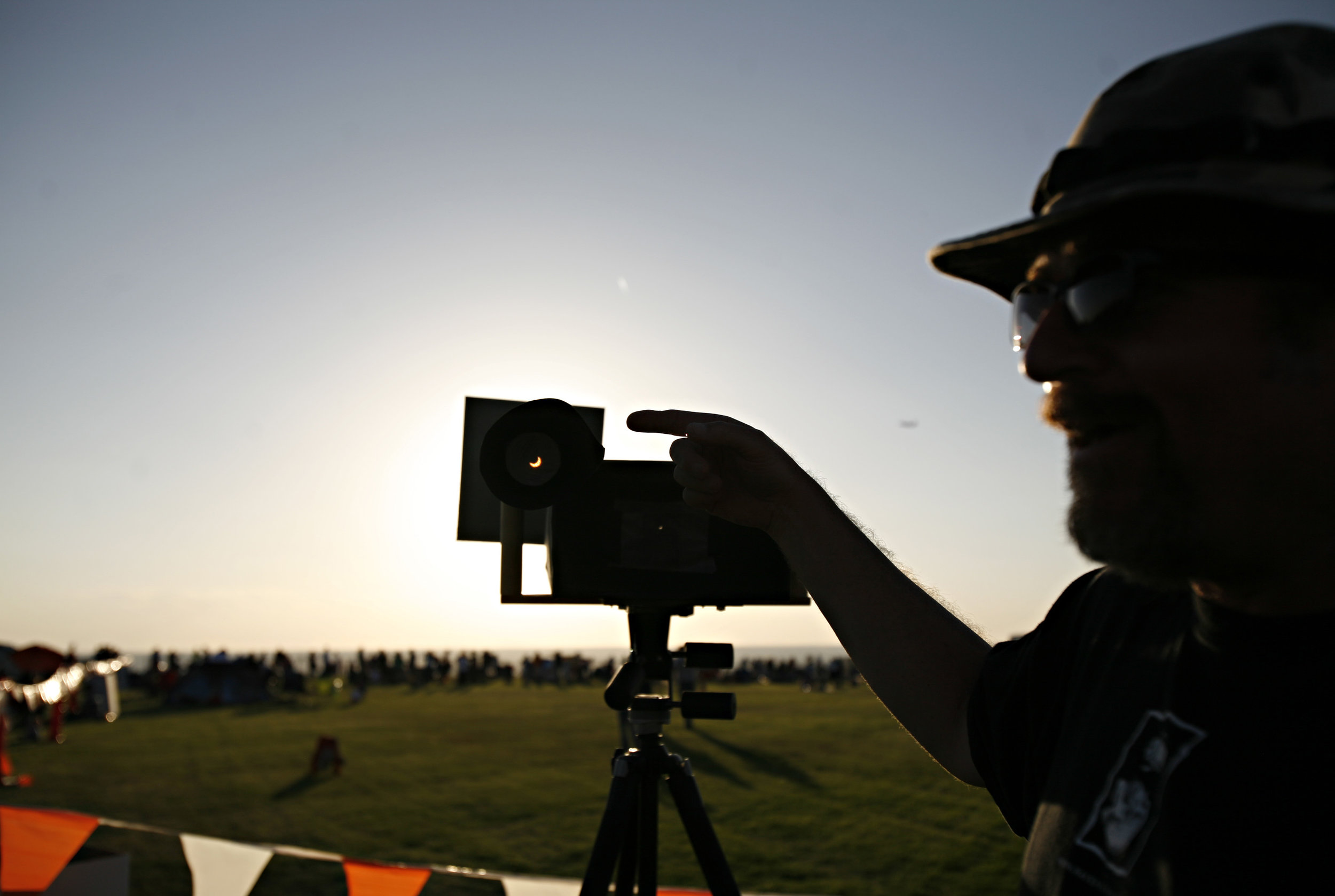 "Joseph Vancleave explains how he made his ""pinholioscopes"" to view the annular solar eclipse. Vancleave joined in the festivities at the eclipse viewing party near the Hard Rock Casino Presents the Pavilion, Sunday, May 20, 2012, in Albuquerque, NM. (Morgan Petroski/Albuquerque Journal)"