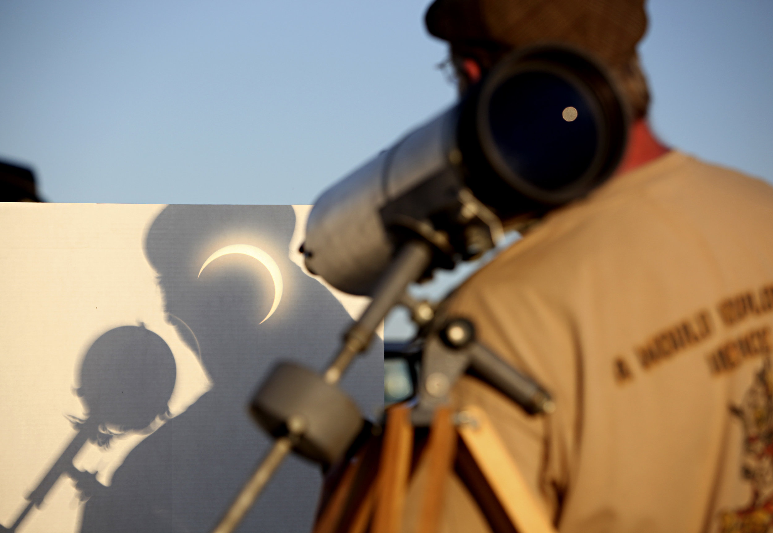 Dave Gallaher, from the University of Colorado in Boulder, CO, watches the annular solar eclipse projected into his shadow during the viewing party near the Hard Rock Casino Presents the Pavilion, Sunday, May 20, 2012, in Albuquerque, NM. (Morgan Petroski/Albuquerque Journal)