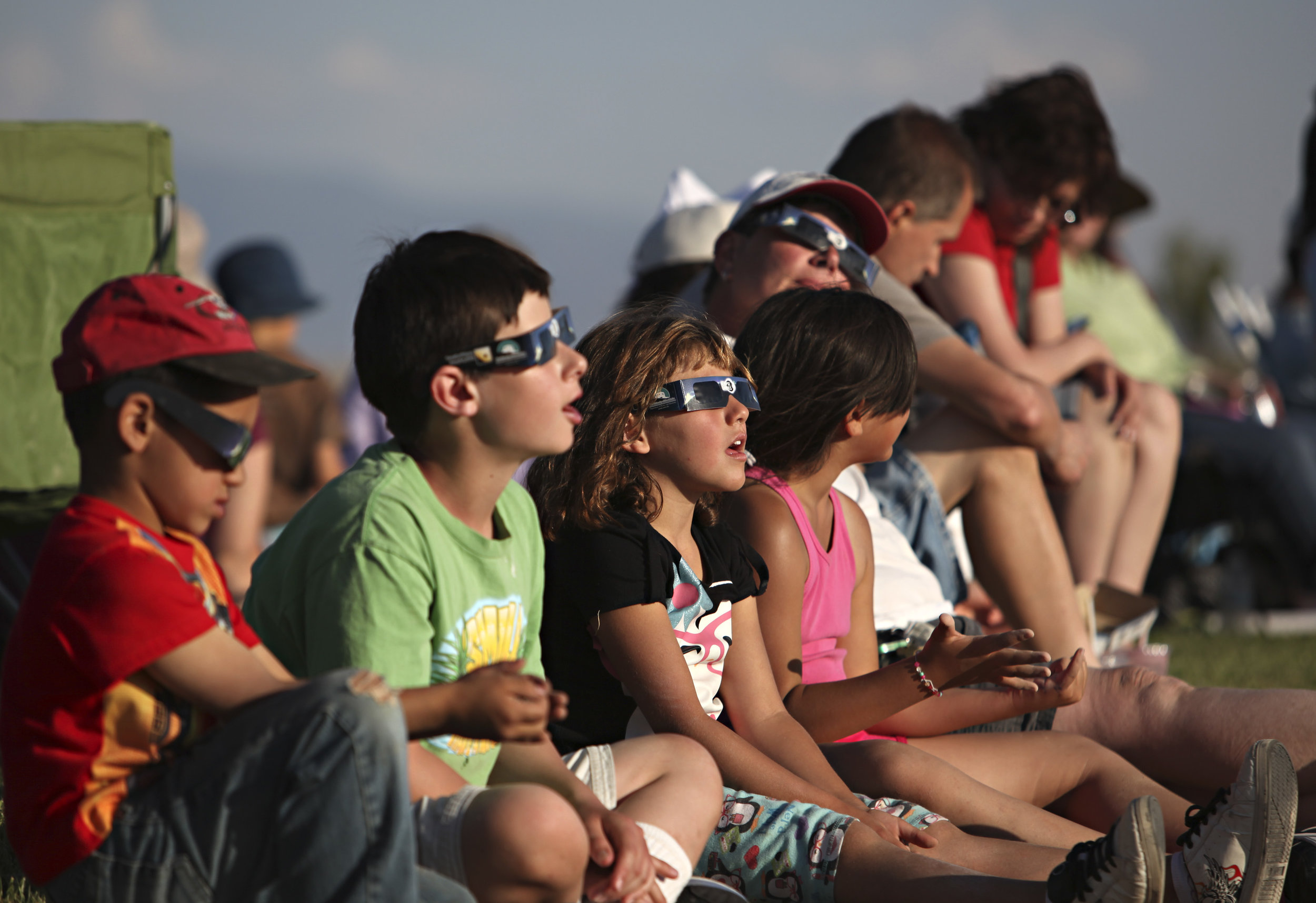 Children watch the annular solar eclipse during a viewing party near the Hard Rock Casino Presents the Pavilion, Sunday, May 20, 2012, in Albuquerque, NM. (Morgan Petroski/Albuquerque Journal)
