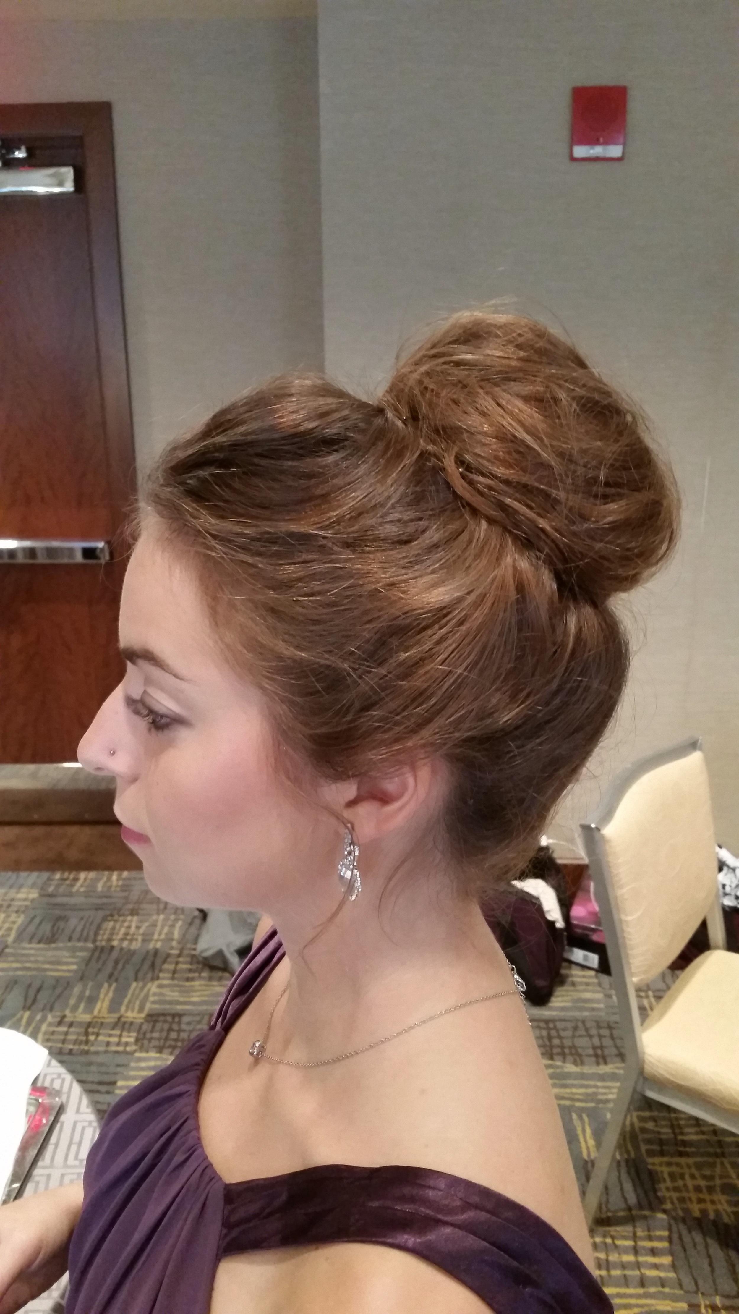 Bridesmaid with a high messy bun