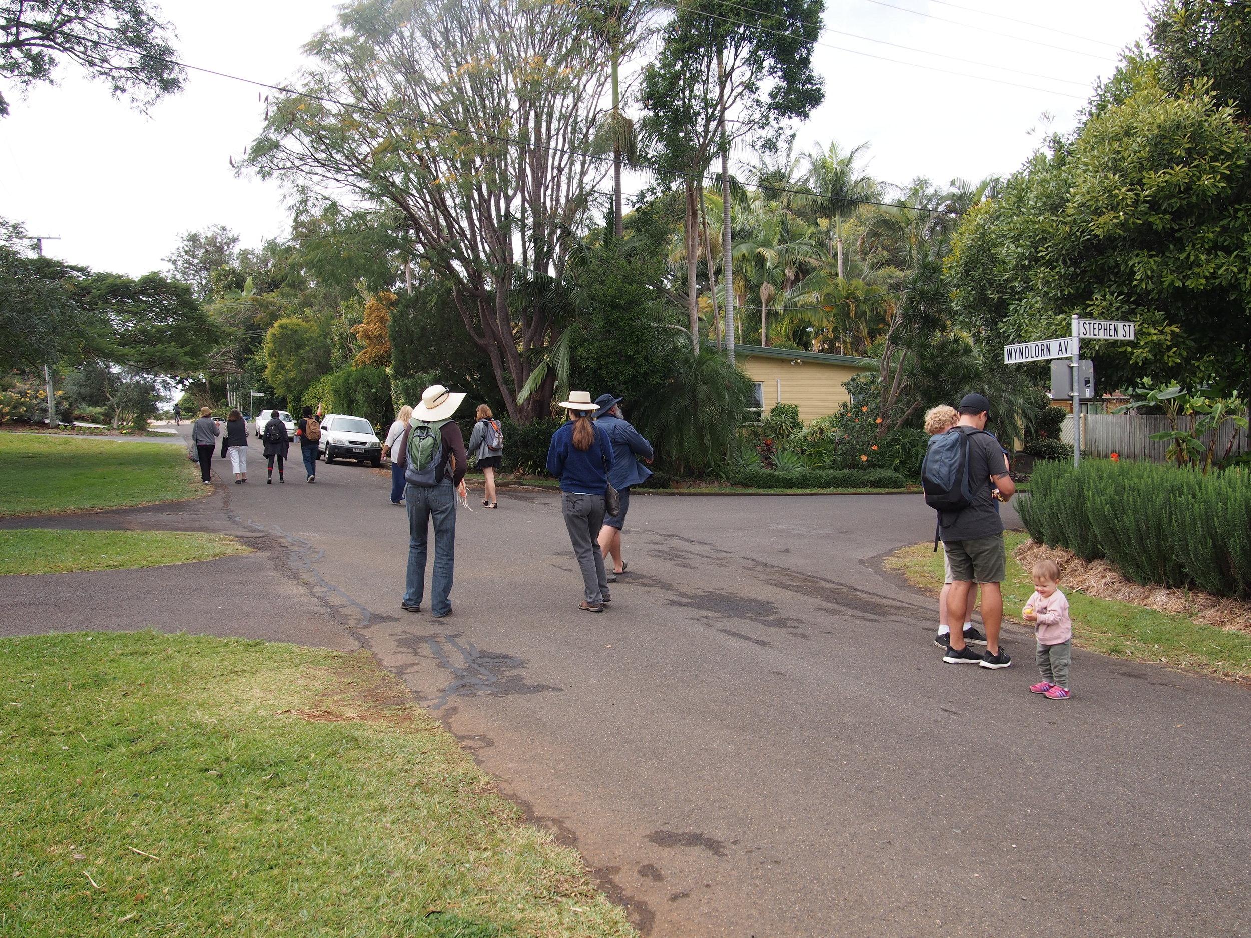 Group of local and international tourists walk the Urban Food Street neighbourhood