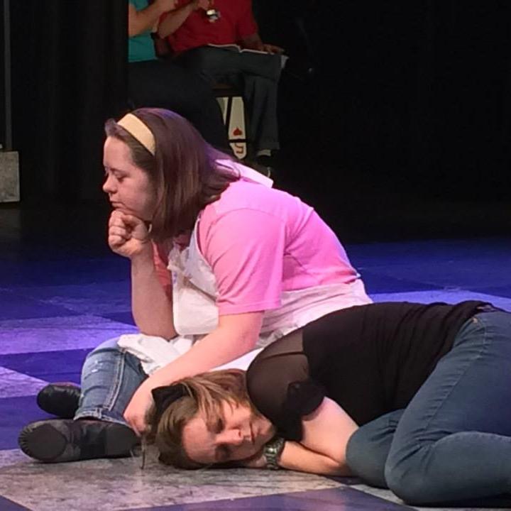 In performance as Dinah in   Adventures in Wonderland
