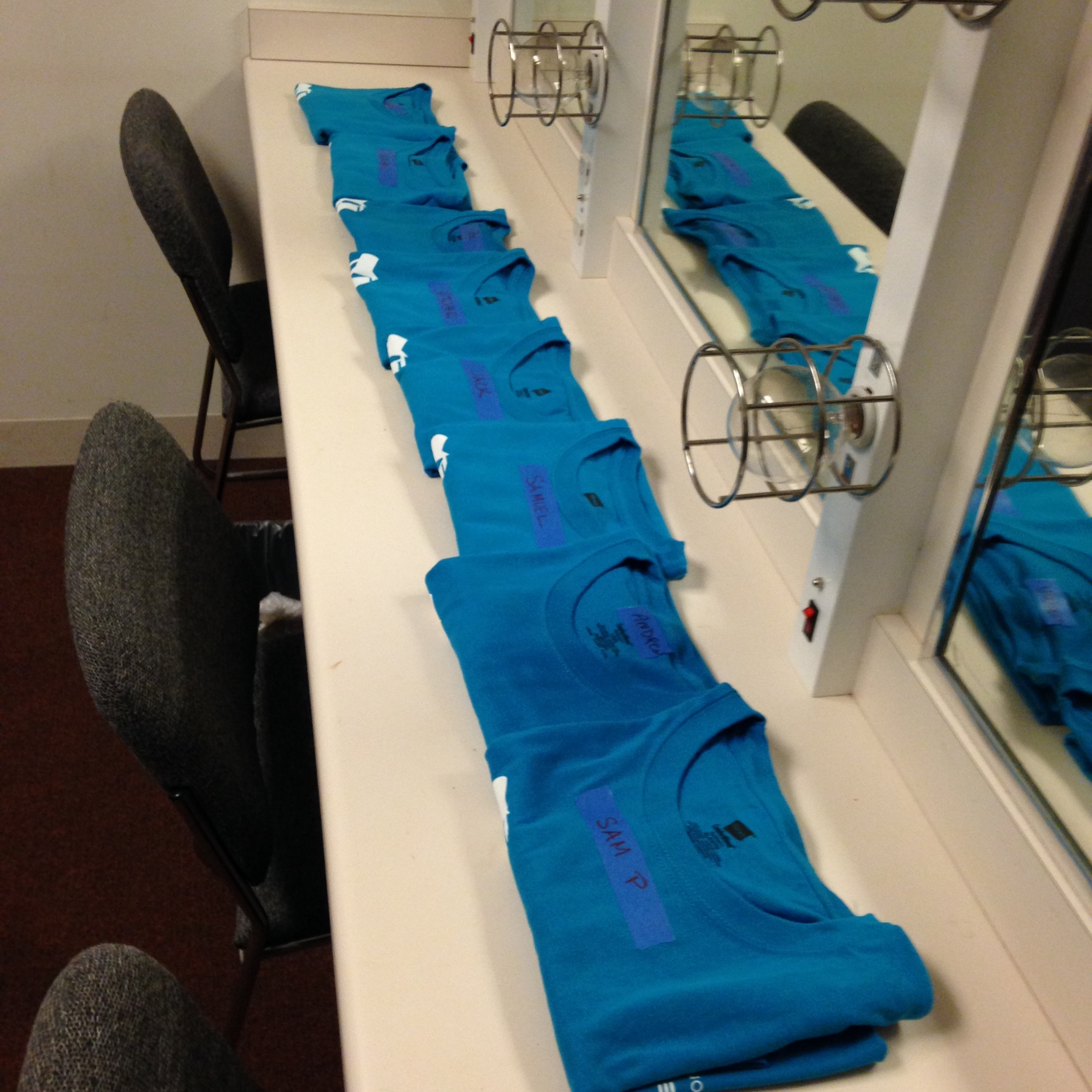 T-shirts lined up and waiting in the Boys' Dressing Room.