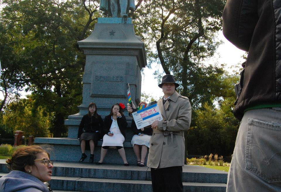 Actor Andrew Kosnik serves as AD filming a scene in Lincoln Park