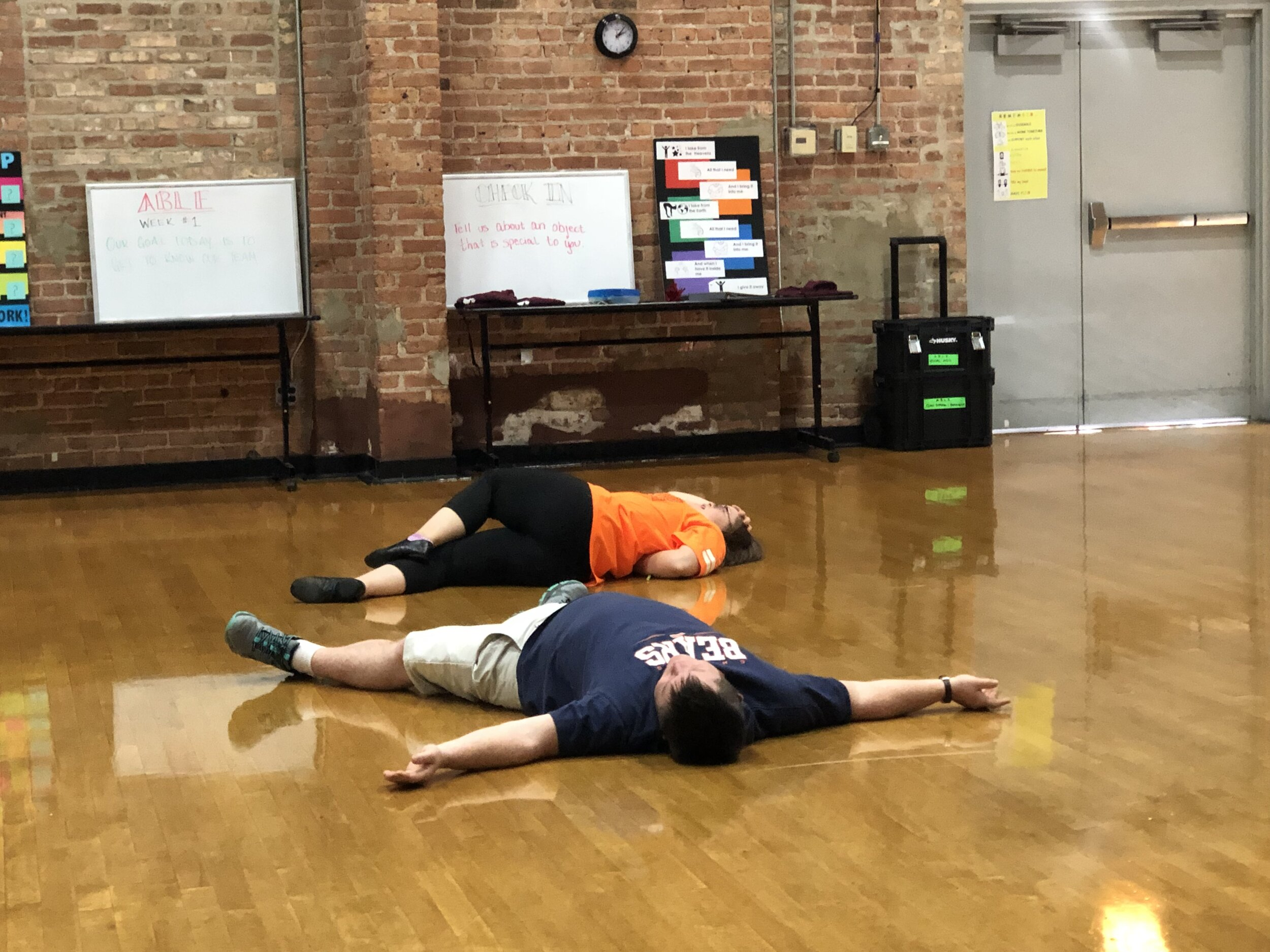 Emily and Matthew lay on the floor after a failed swimming attempt in their scene