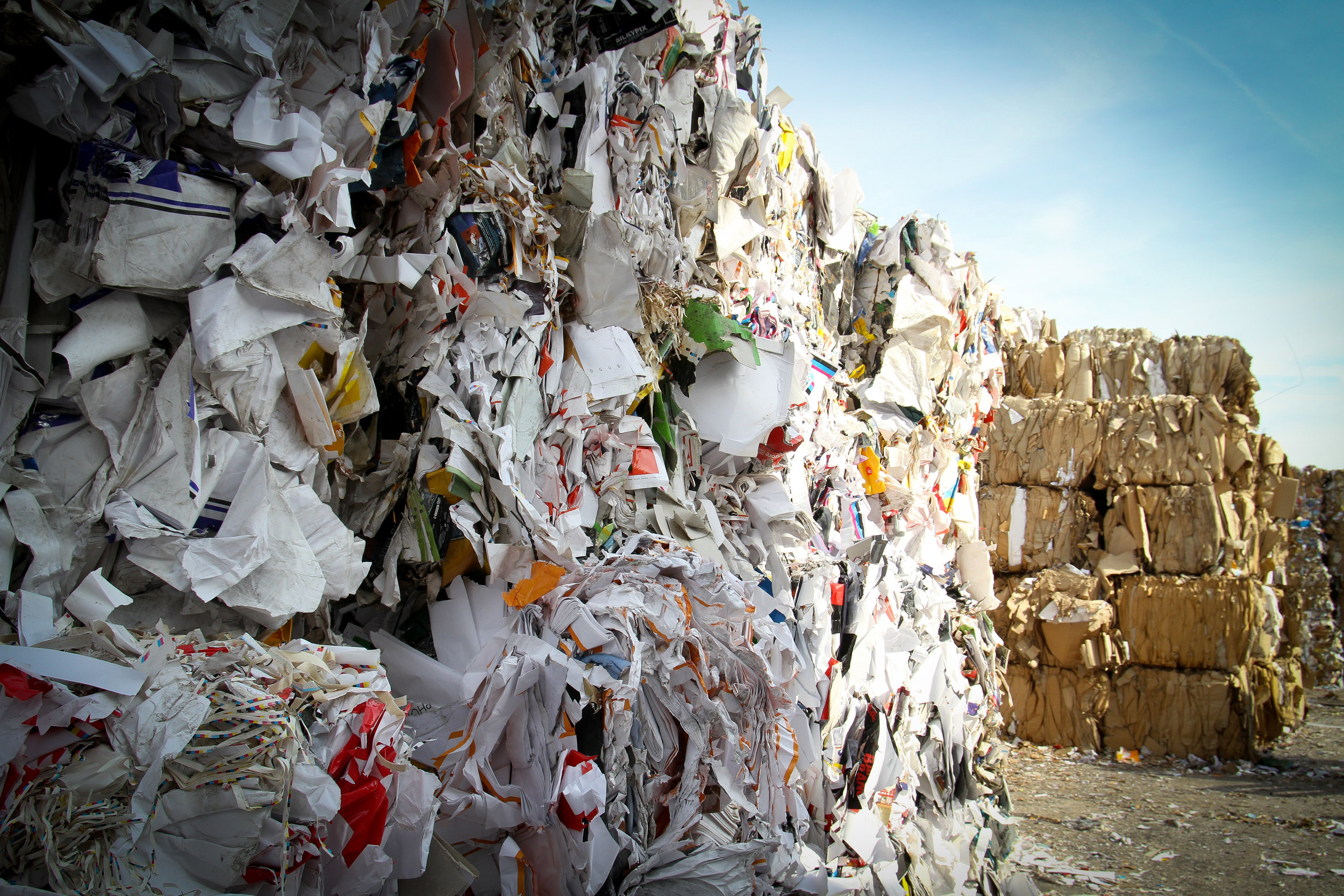 Large cubes of compacted trash at a landfill.