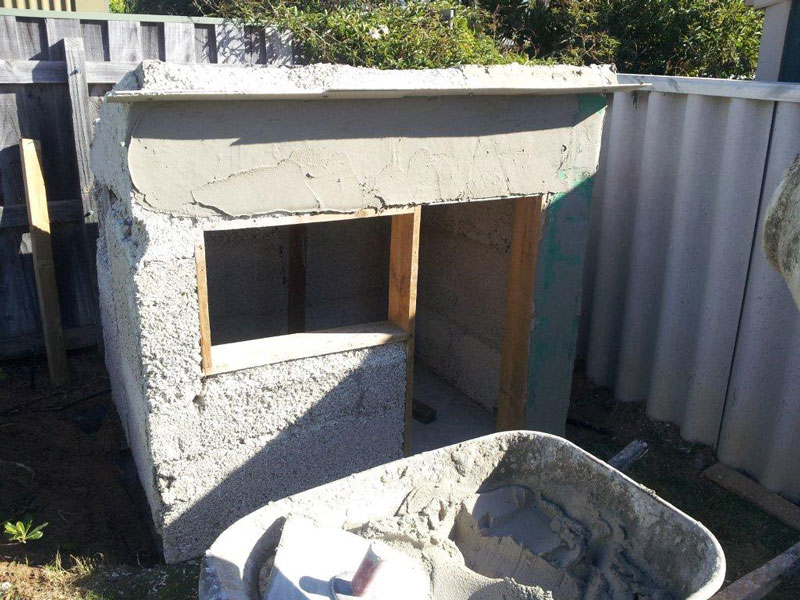 Lime render being applied to hemp cubby house