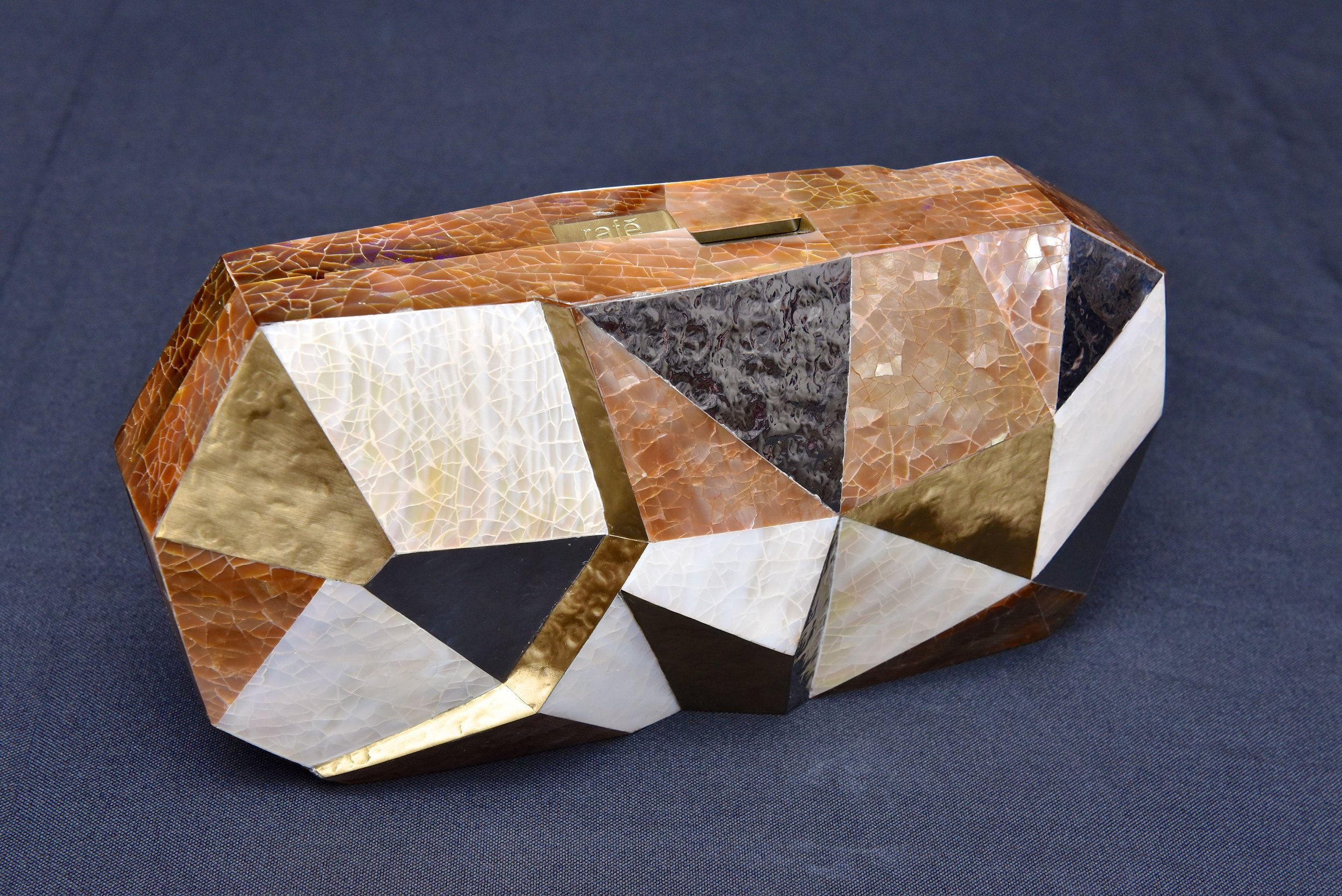 The Vivienne Faceted Minaudière in multi-shell inlay.